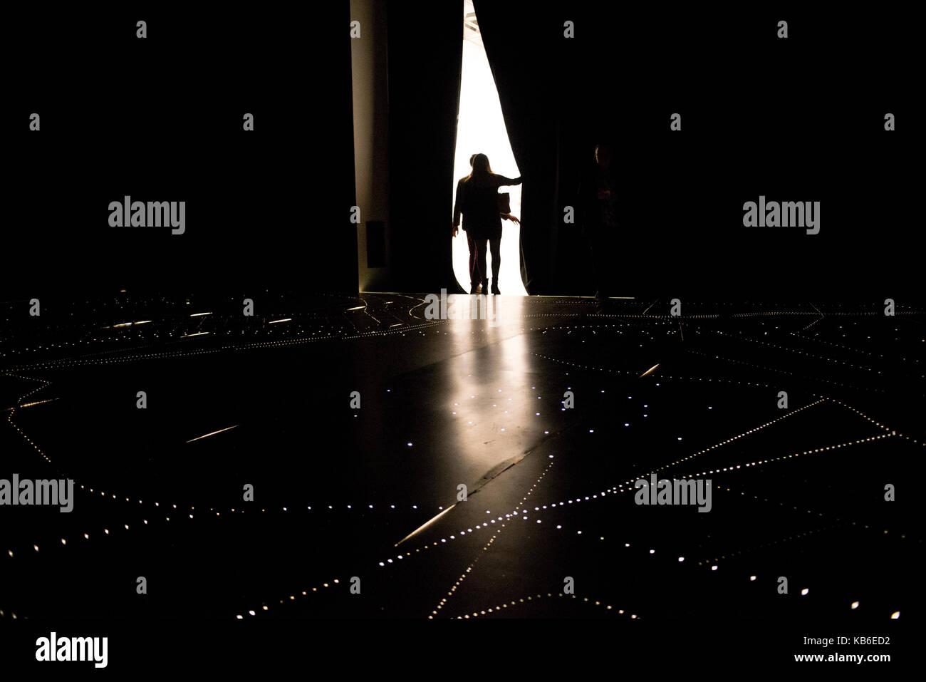 Two people leaving an installation of Carlos Garaicoa at the Center for Contemporary Art Luigi Pecci in Prato, Italy - Stock Image