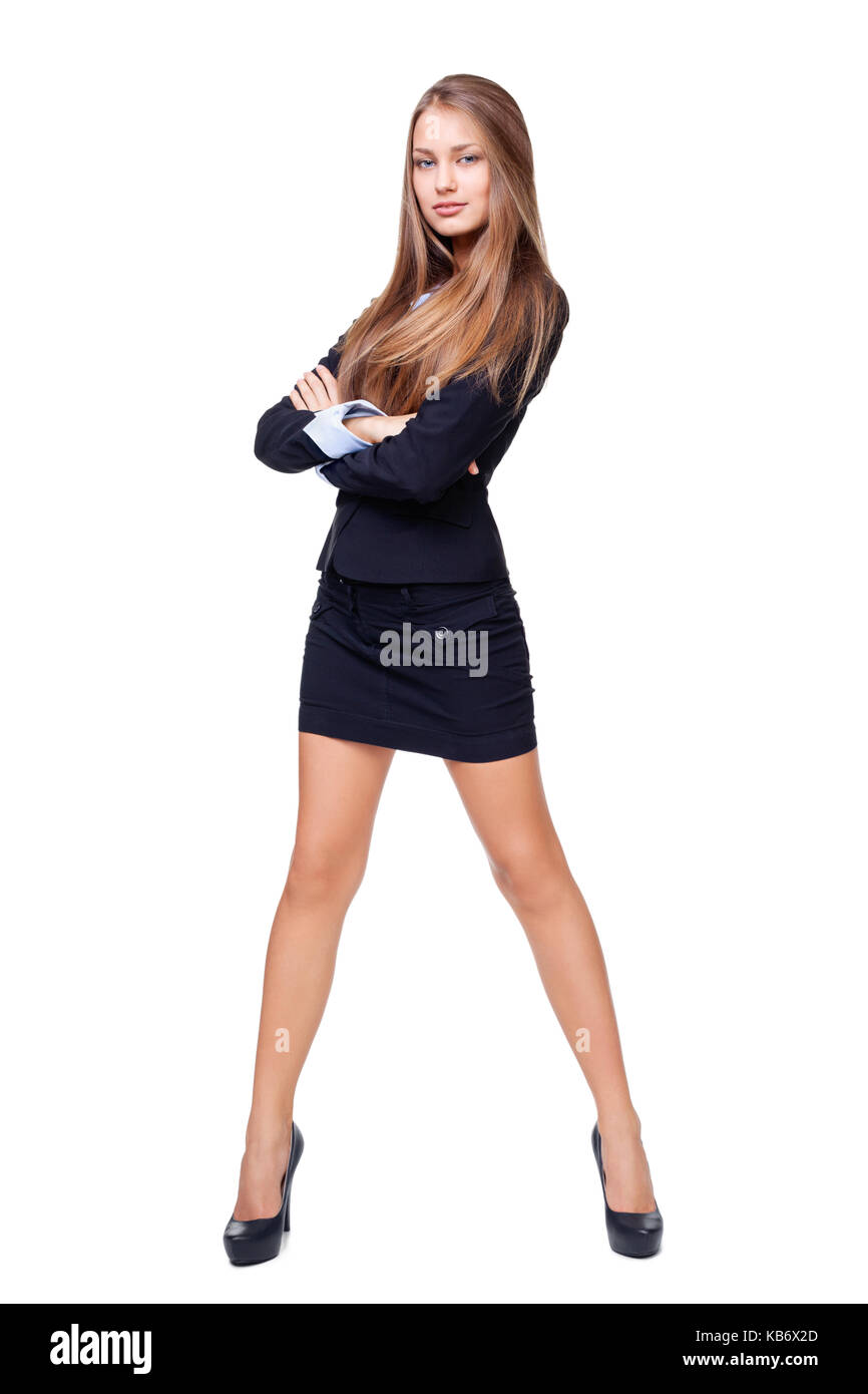 b07ec4f3e7 Full length portrait of a beautiful business woman standing with hands  folded against isolated on white