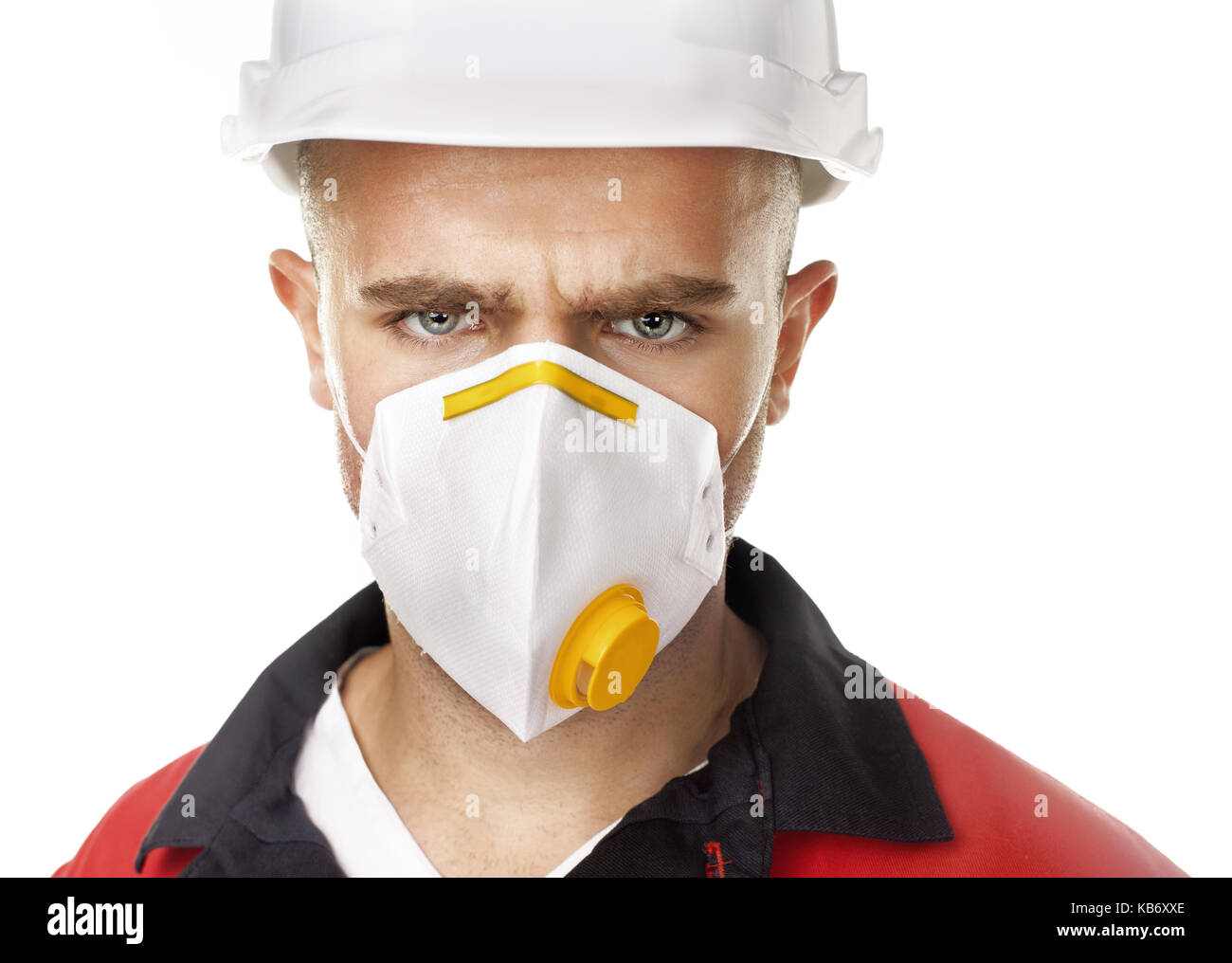 Closeup portrait of serious worker wearing respirator and white helmet isolated on white background - Stock Image