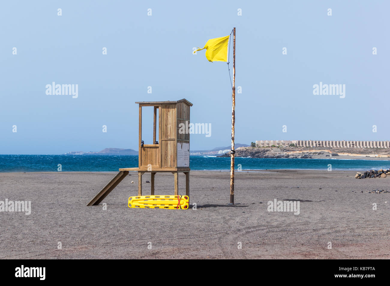 2777032b9cb9 Lonely lifeguard hut with yellow rescue tube on a sandy beach in Tenerife.  Blue sea