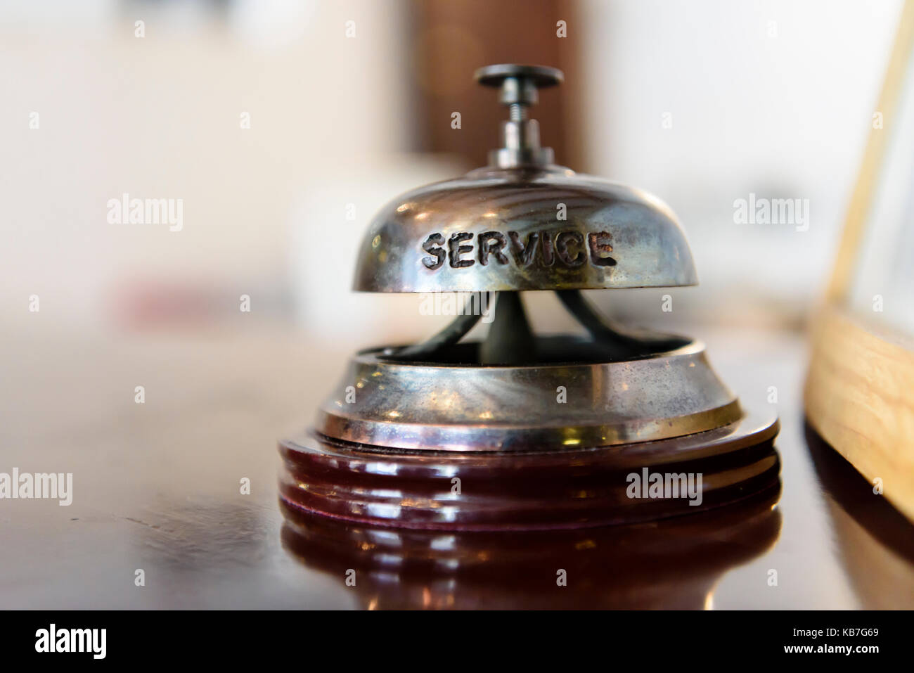 Service bell on the reception desk of a hotel. - Stock Image