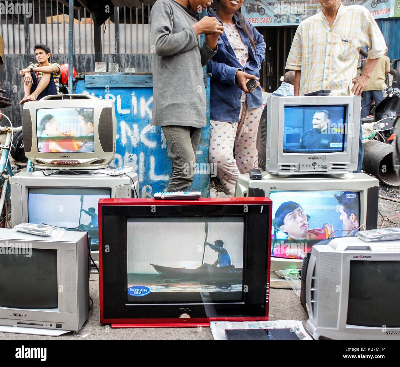 Used television sell at street market, Palembang, Sumatera - Stock Image