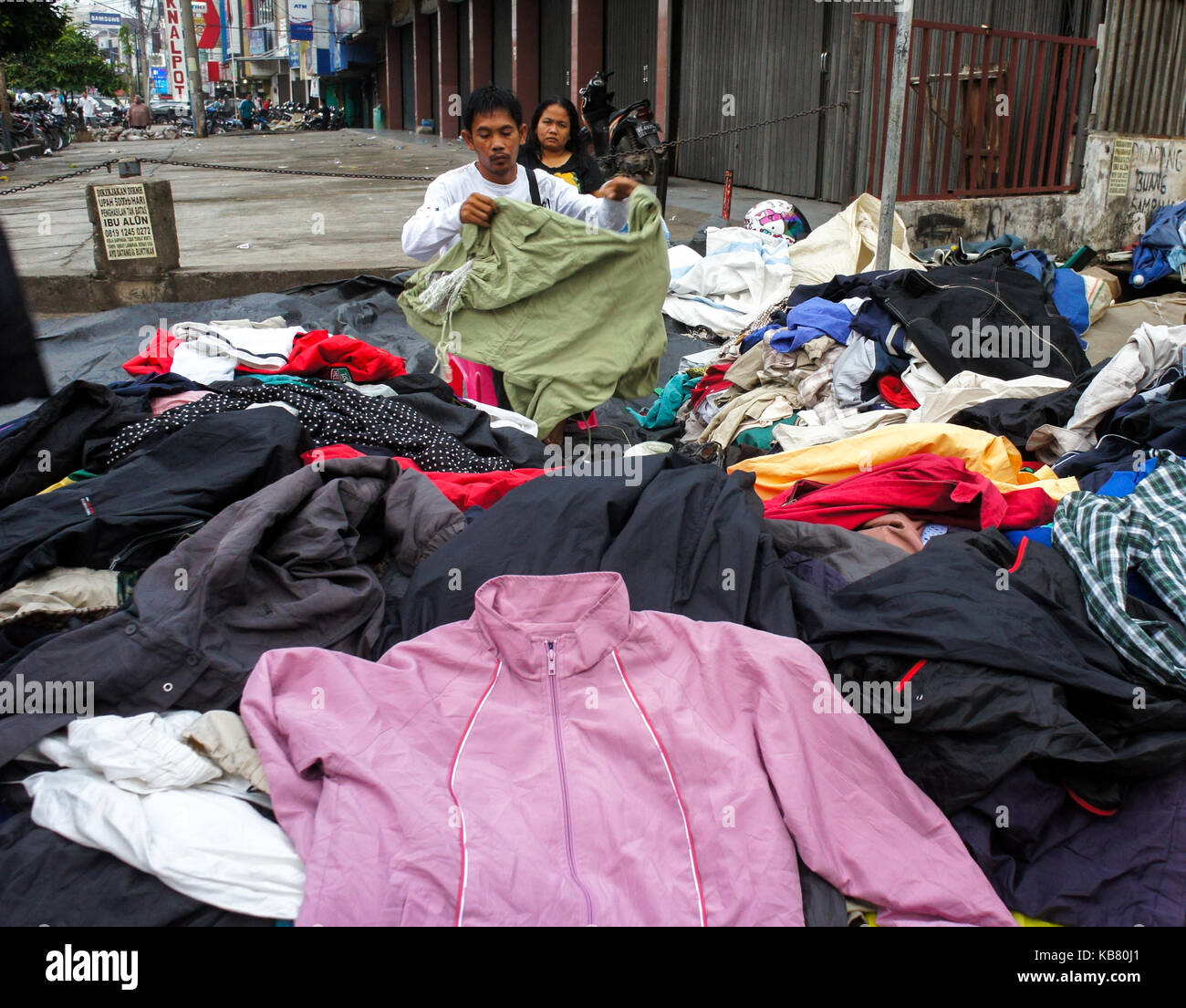 street vendor sells used cloths, Palembang City, South Sumatera, Indonesia - Stock Image