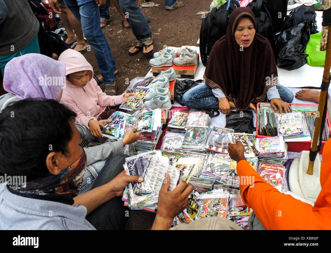Street vendor sells DVD at used stuff market, Palembang, South Sumatera, Indonesia - Stock Image