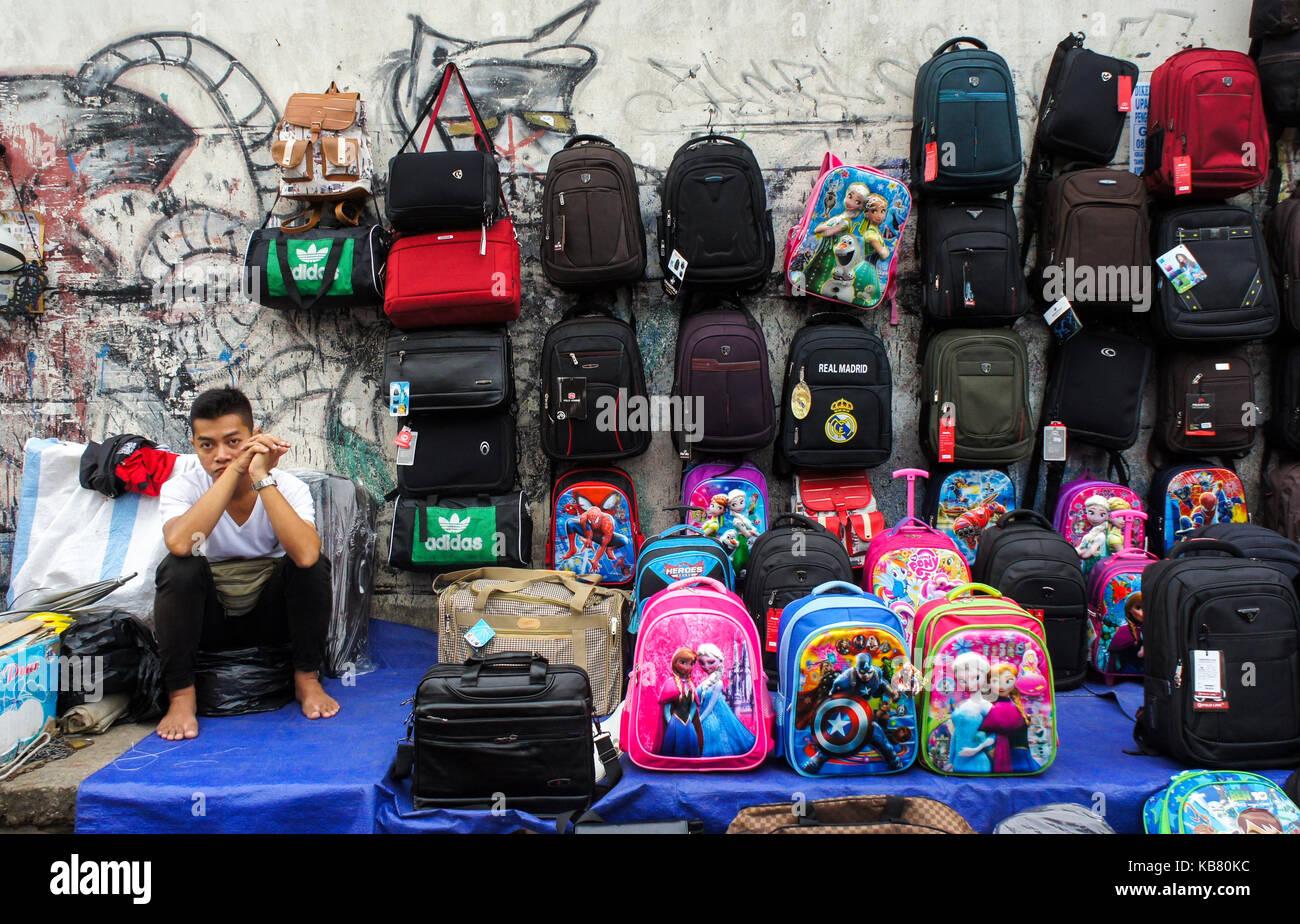 Street vendor sells various backpacks at Palembang City, South Sumatera -  Stock Image