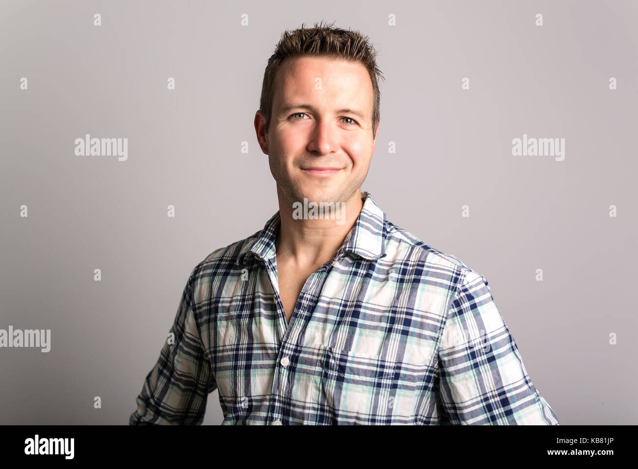 handsome dude in grey, portrait - Stock Image