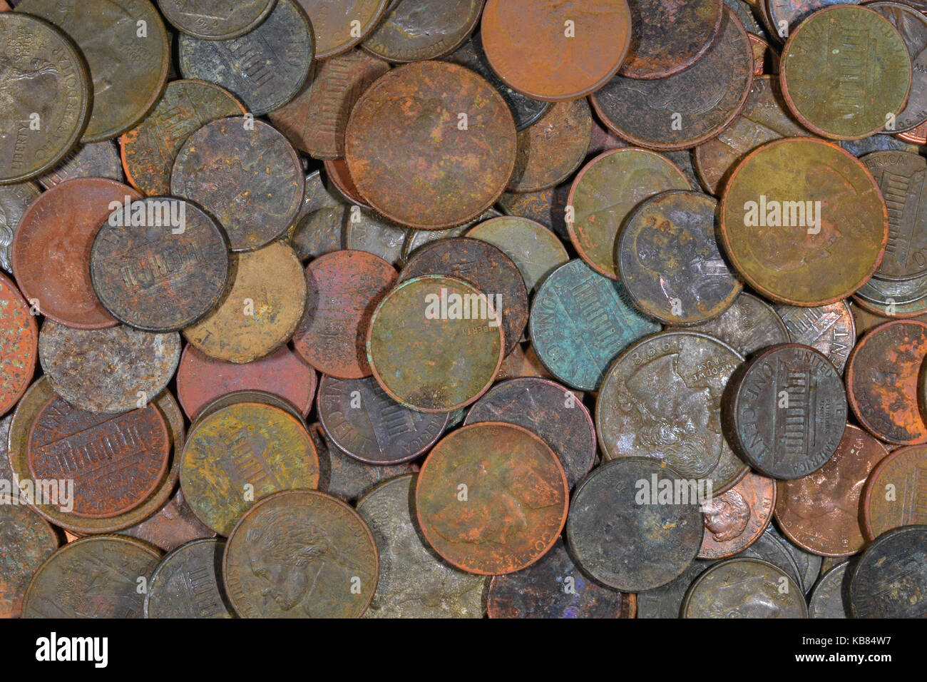 Assortment of dirty US coins found with a metal detector. - Stock Image
