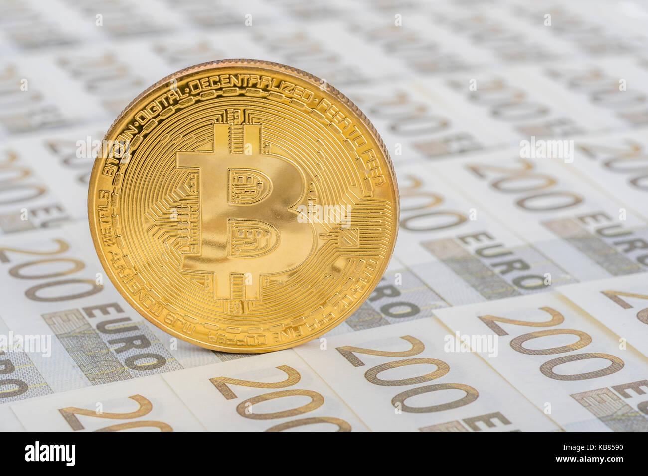 Gold Bitcoin on 200 Euro banknote - as metaphor for European Digital Single Market, Bitcoin-Euro exchange rate, - Stock Image