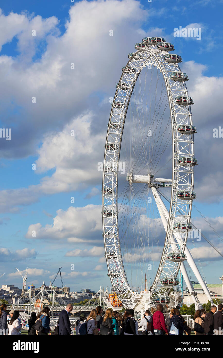 LONDON - SEPTEMBER 2017; People on the westminster bridge with London Eye on the background. Stock Photo