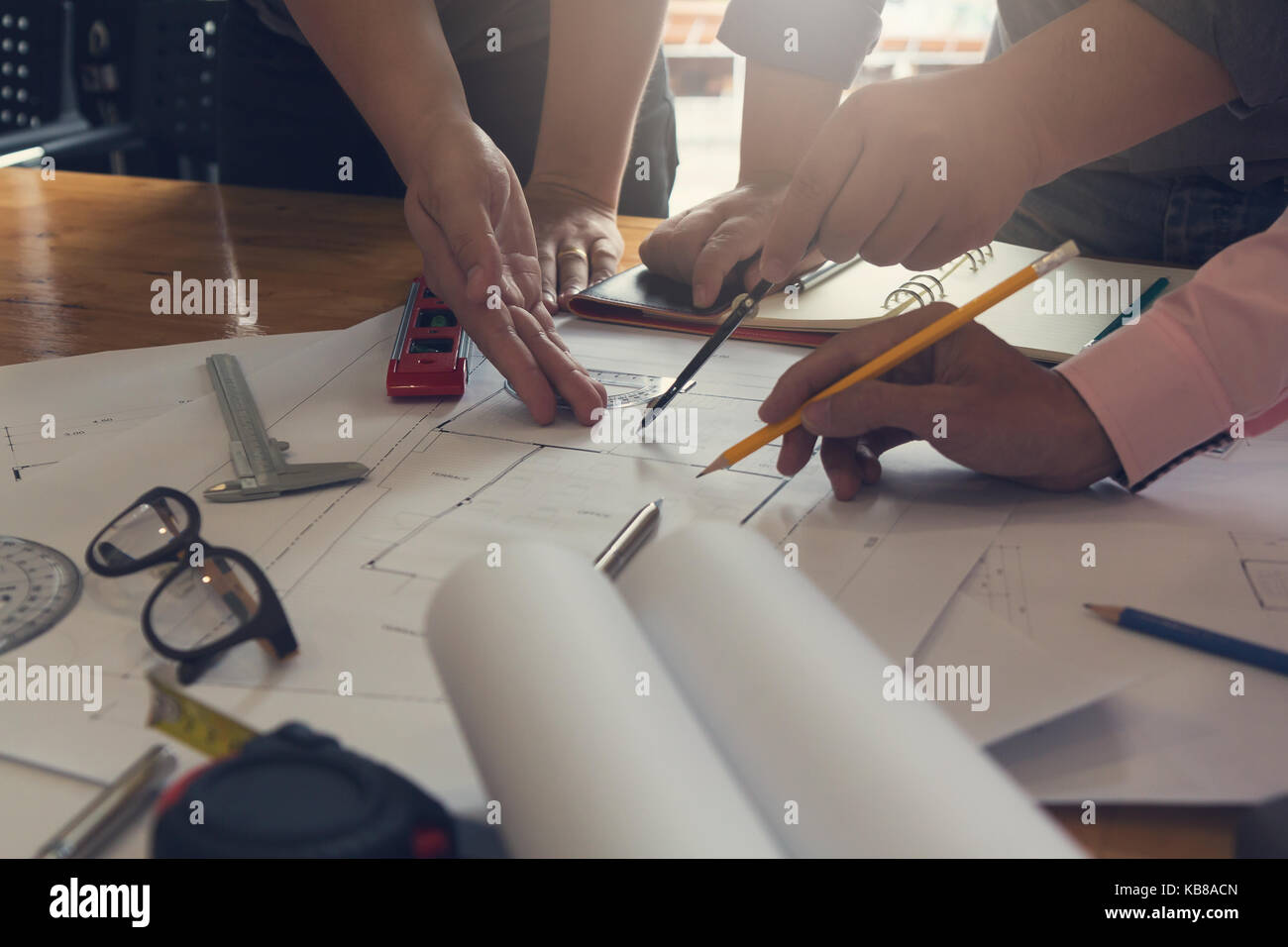 Engineer and Architect concept, Engineer Architects office team working and discussing house plan  model, Vintage - Stock Image