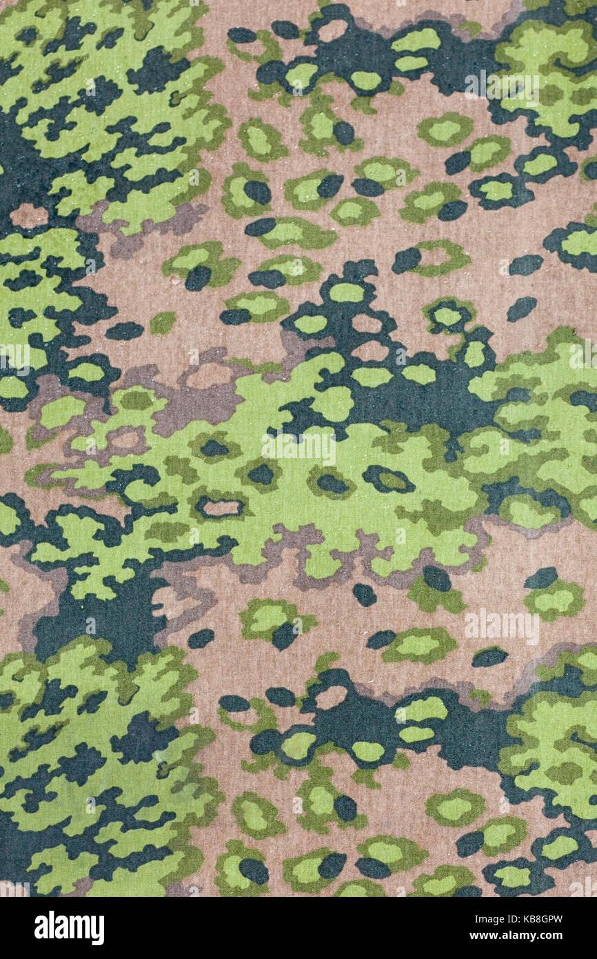 camouflaged fabric pattern - Stock Image