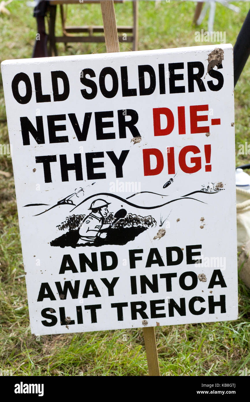 Old soldiers never die, they dig and fade away into a slit trench sign at a WW11 Reenactment at the Victory show - Stock Image