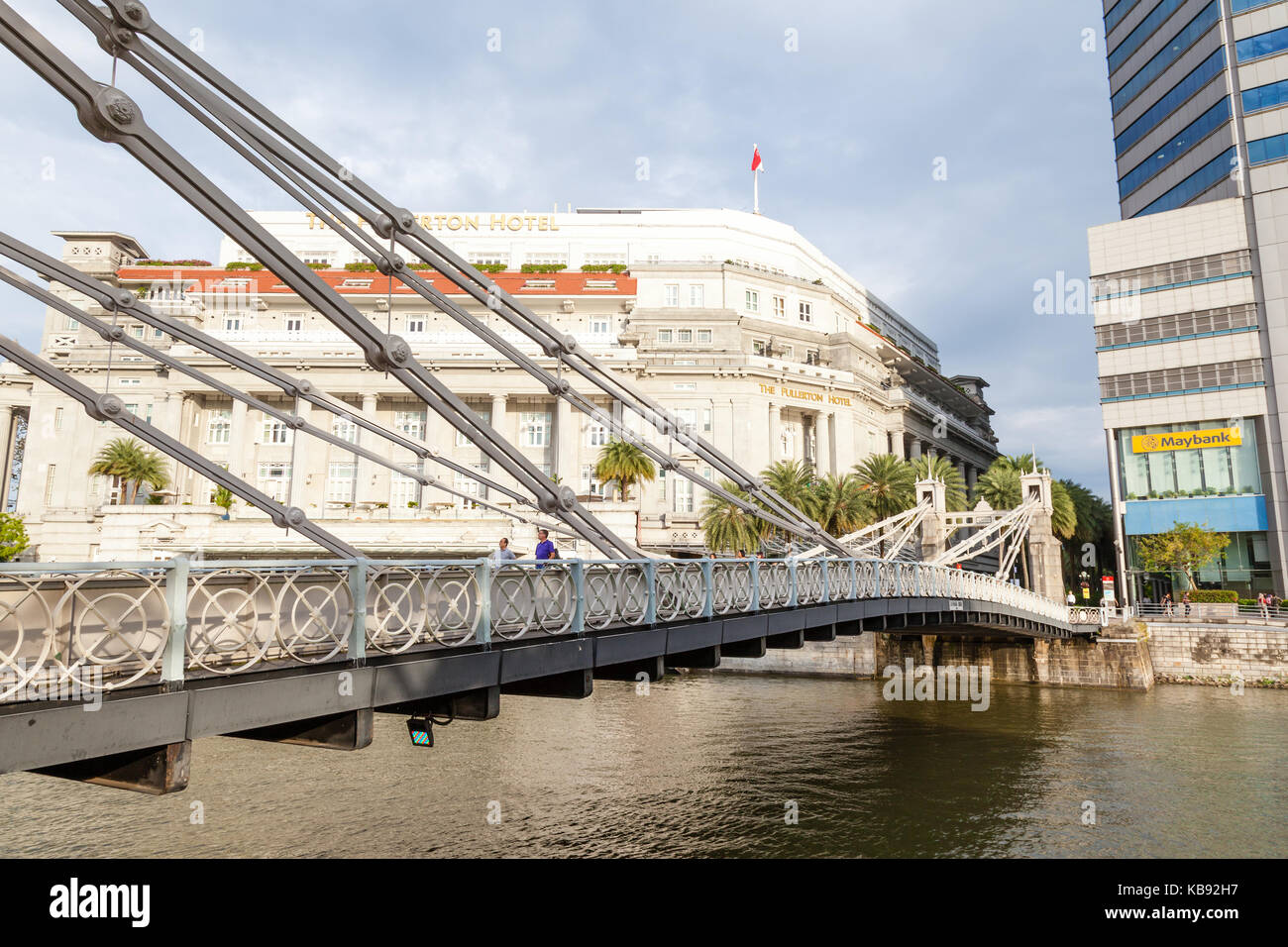 SINGAPORE - SEPTEMBER 6, 2017: Cavenagh Bridge over the Singapore River is one of the oldest bridges and the only - Stock Image