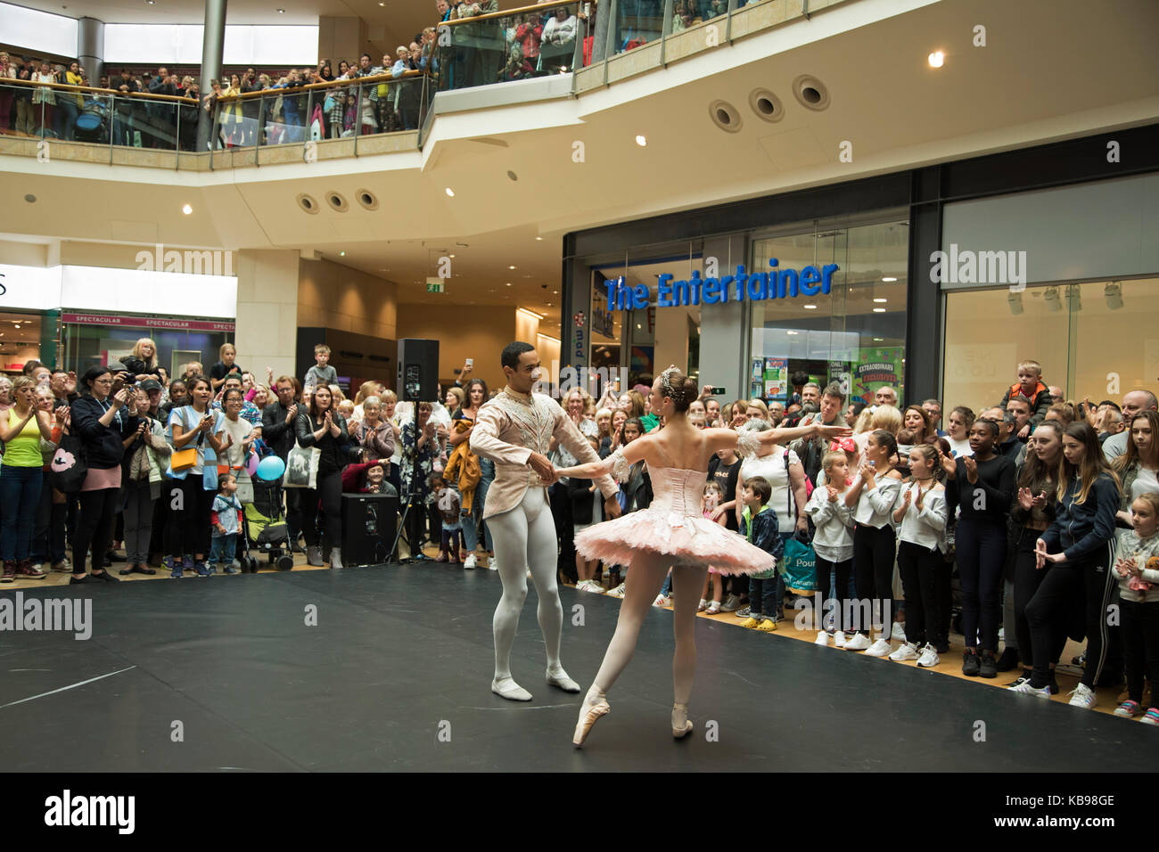 Members of the Birmingham Royal Ballet perform a section from The Nutcracker in the Bullring to a packed audience - Stock Image