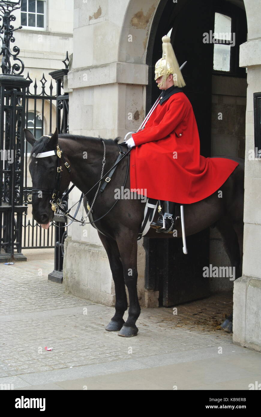 Mounted Household Cavalryman guard outside entrance to Horseguards Parade, Whitehall, London, England, UK - Stock Image