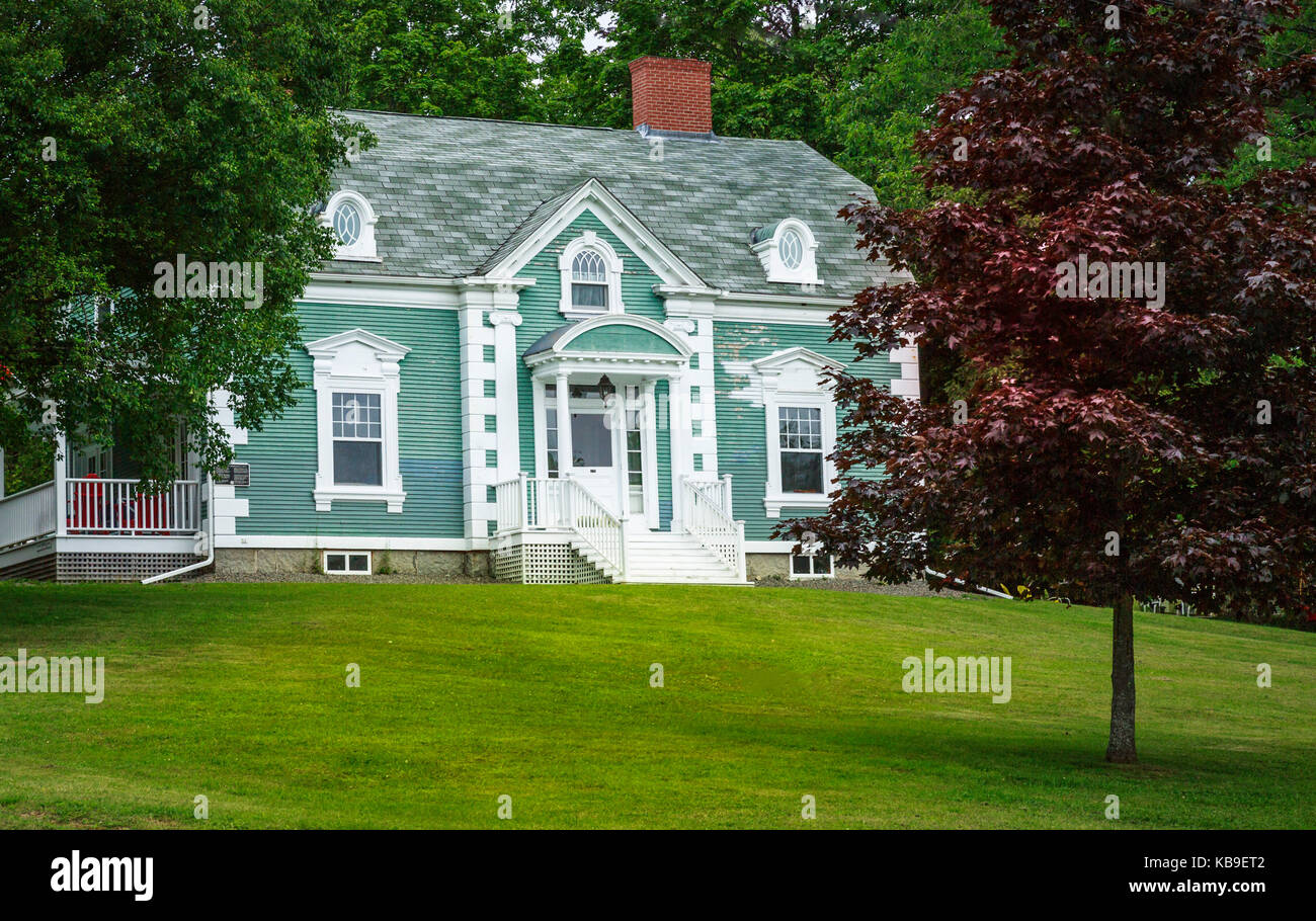 cape cod style home with expansive lawn in north america stock photo