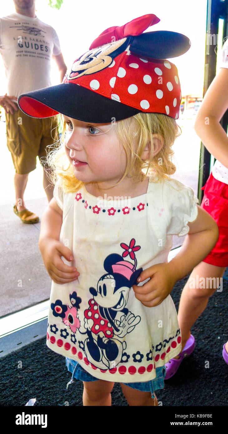 4e48216535665c Toddler wearing a minnie mouse t-shirt and hat with ears in red and white