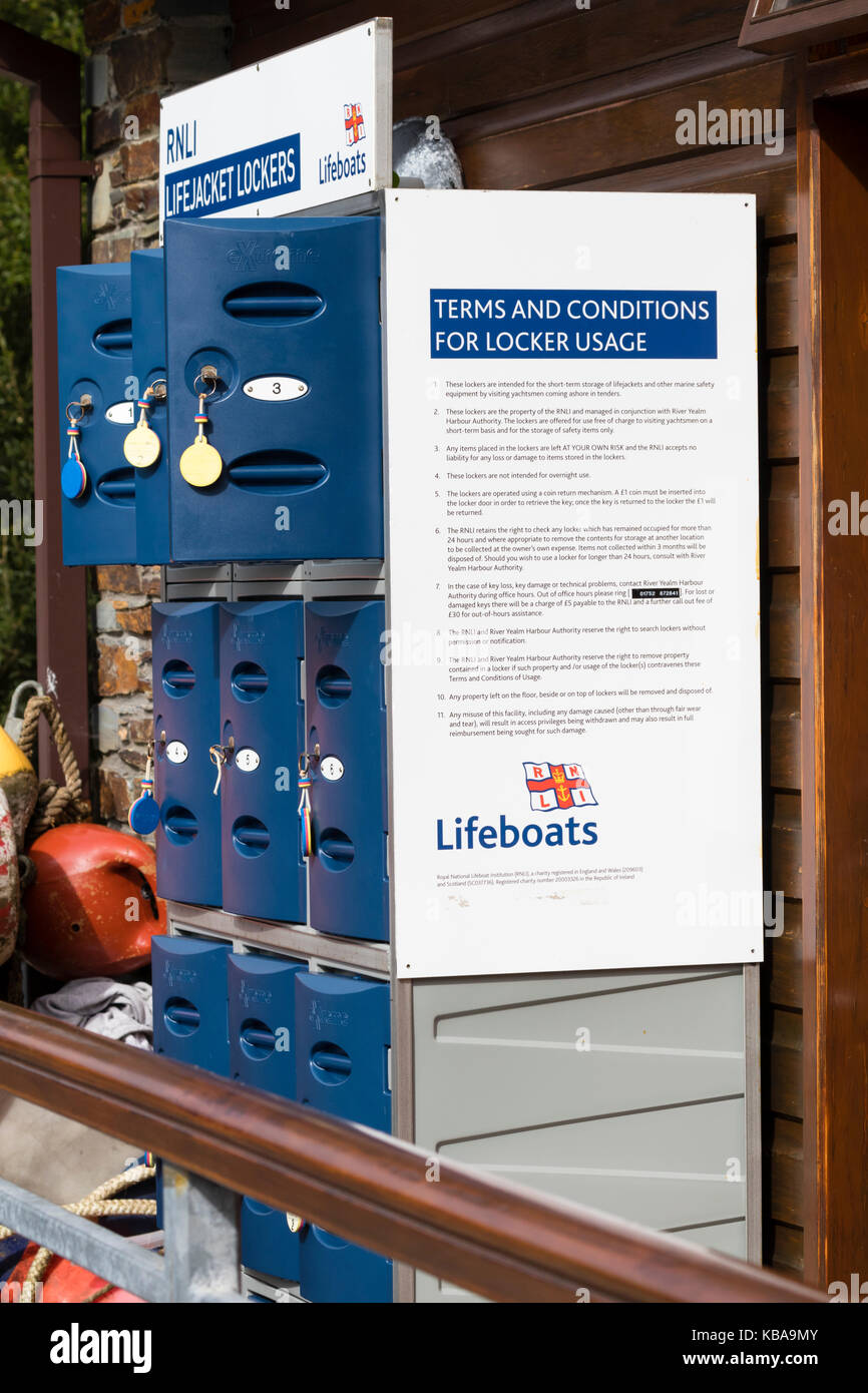 Coin operated lifejacket RNLI lockers at Trebeurden Quay, Newton Ferrers on the River Yealm, Devon, UK - Stock Image