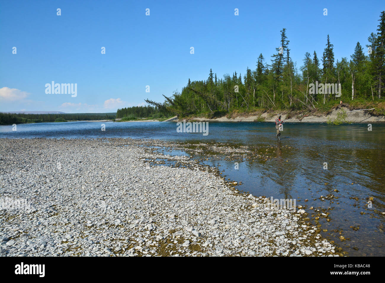 Fishing in the Polar Urals. Summer water landscape and fascinating nobby. - Stock Image