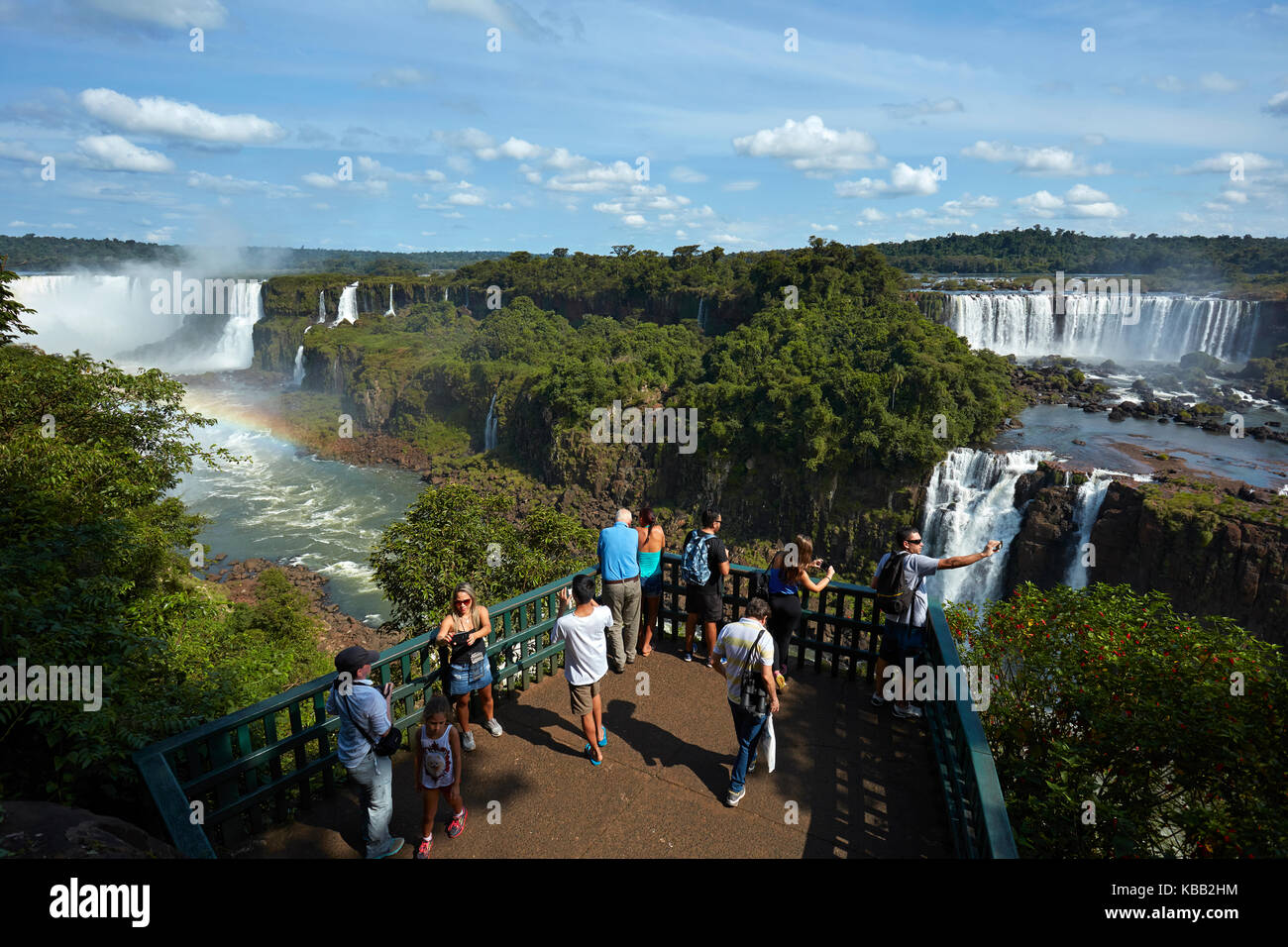 Tourists on viewing platform on Brazil side of Iguazu Falls, looking at Argentinian  side, South America Stock Photo