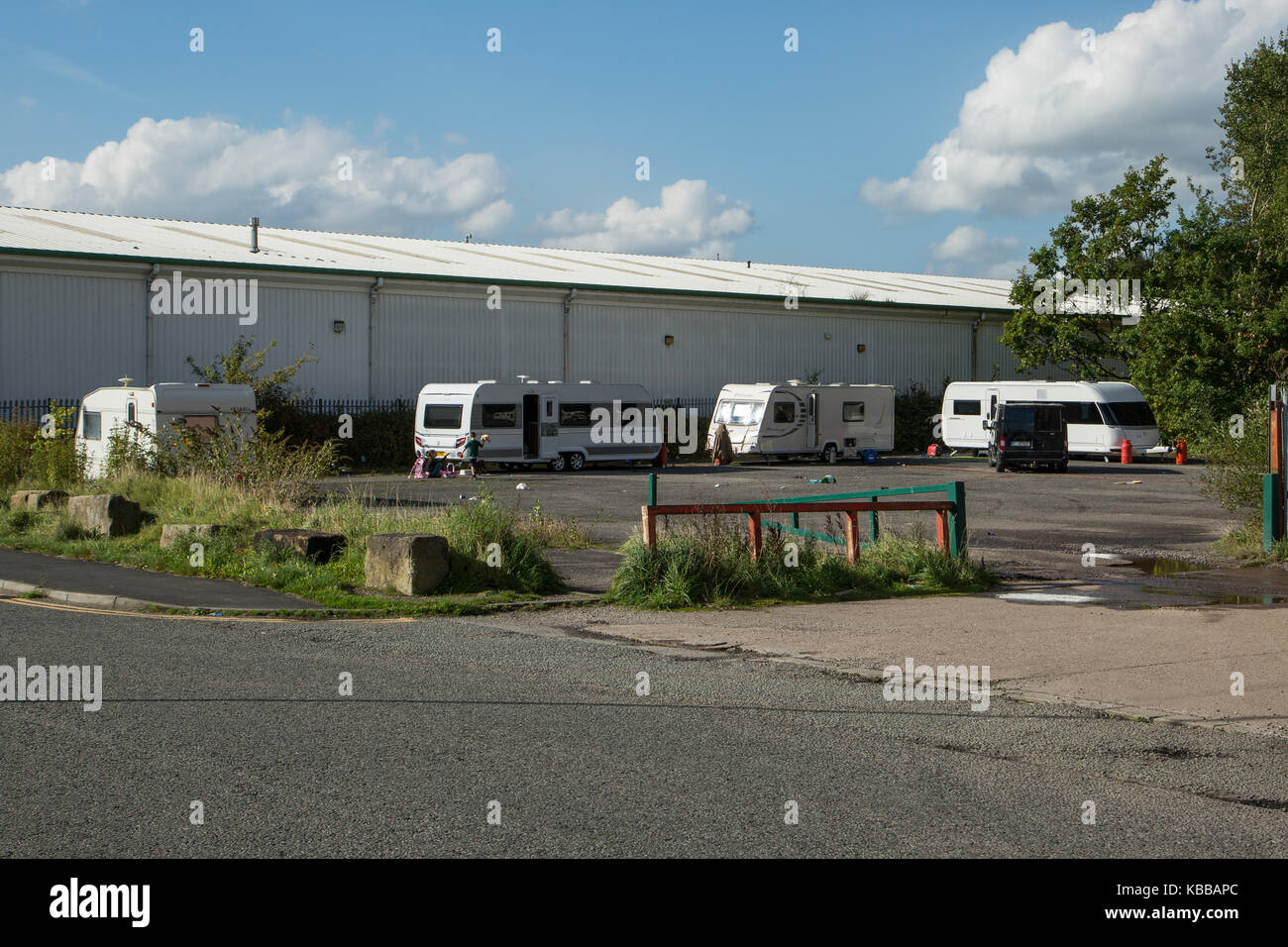 Travellers and caravans on land off Butts Street In Leigh, England, UK Stock Photo