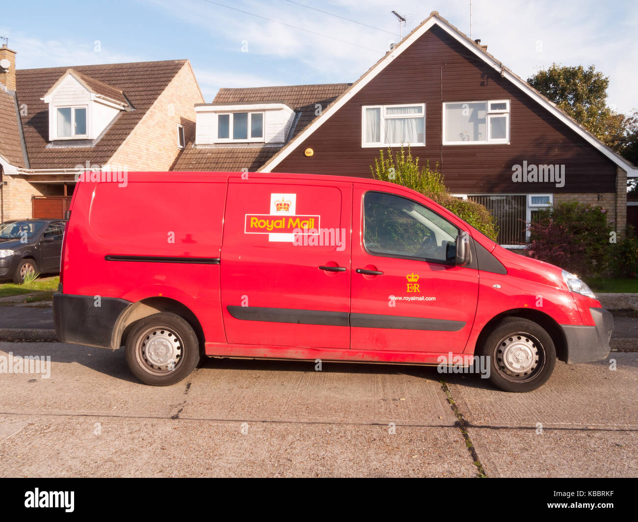 royal mail post red van parked side view; Essex; England; UK - Stock Image