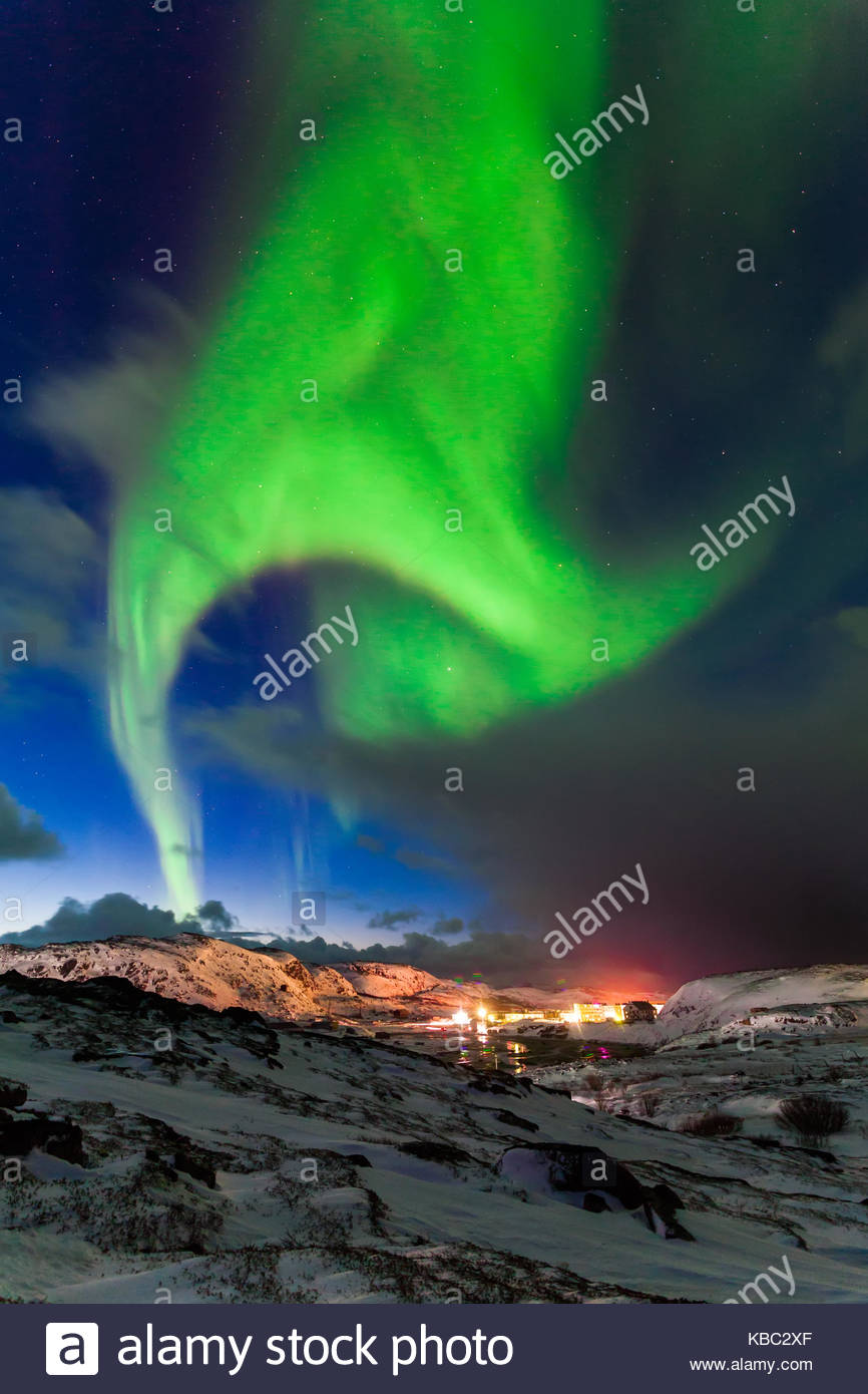 Northern lights above the fjord in Norway - Stock Image