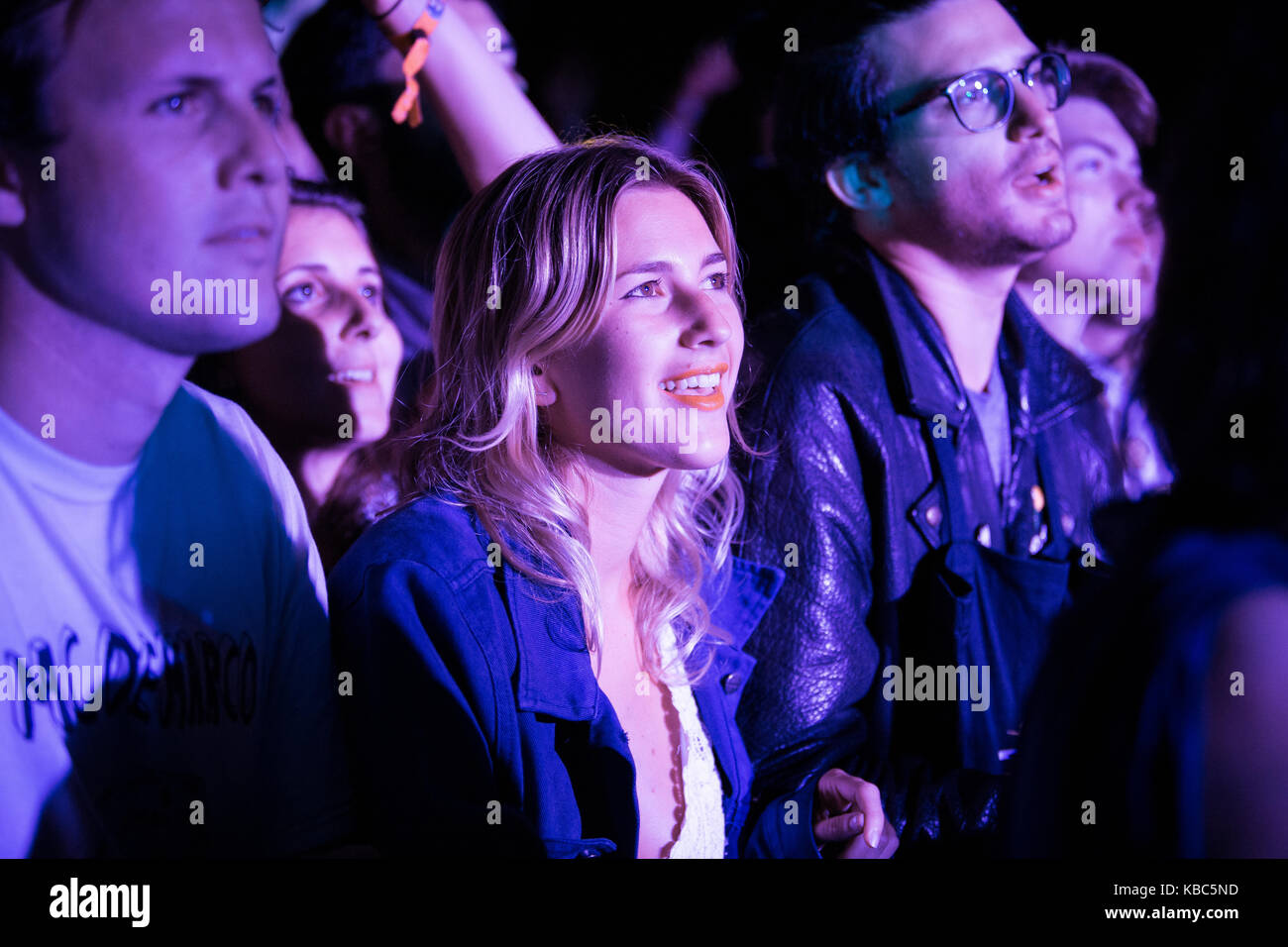Festival goers and music fans attend a concert with the Australian band Tame Impala who performs at the music festival - Stock Image