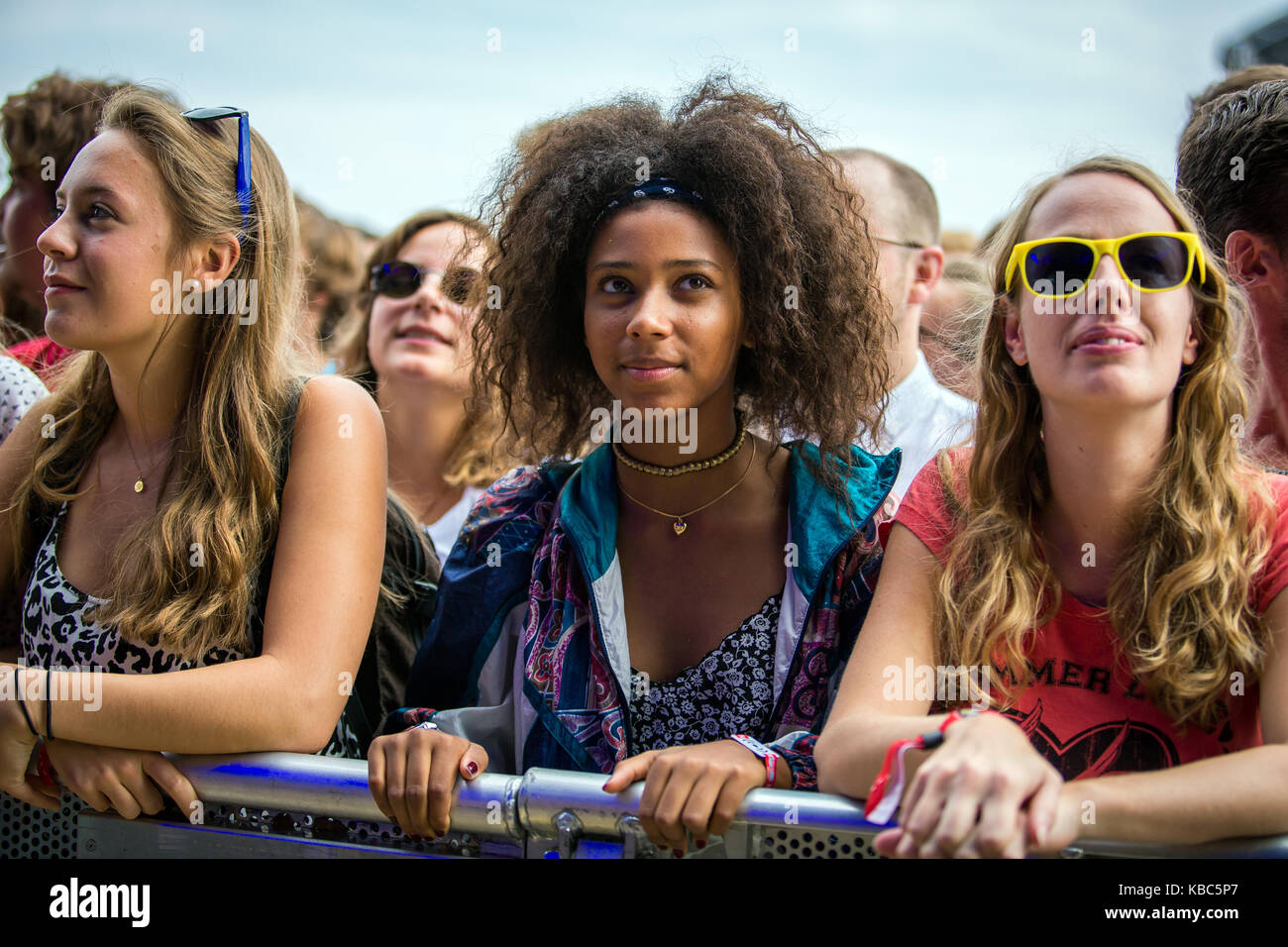 Enthusiastic and energetic music fans attend a concert with the American rap duo Run the Jewels who performs at - Stock Image