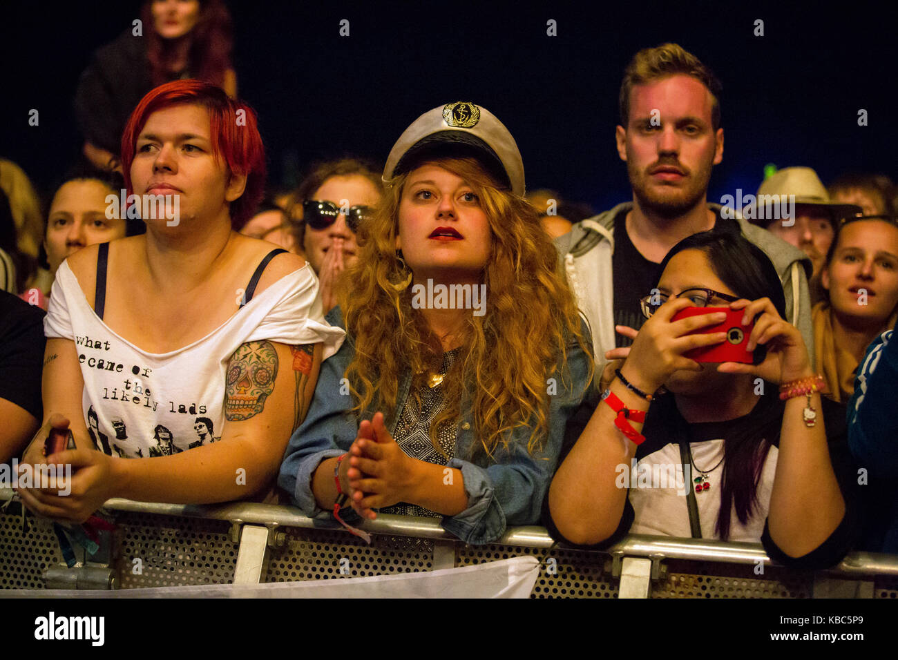 Festival goers and music fans attend a concert with the British band The Libertiens who performs at the music festival - Stock Image