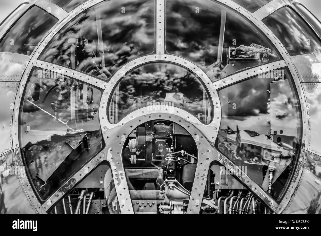 The sky reflecting off the front of a World War Two bomber's cockpit. - Stock Image