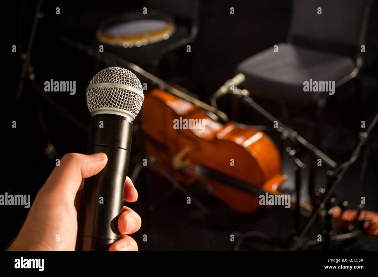 Audio microphone and blur musical instrument background Stock Photo