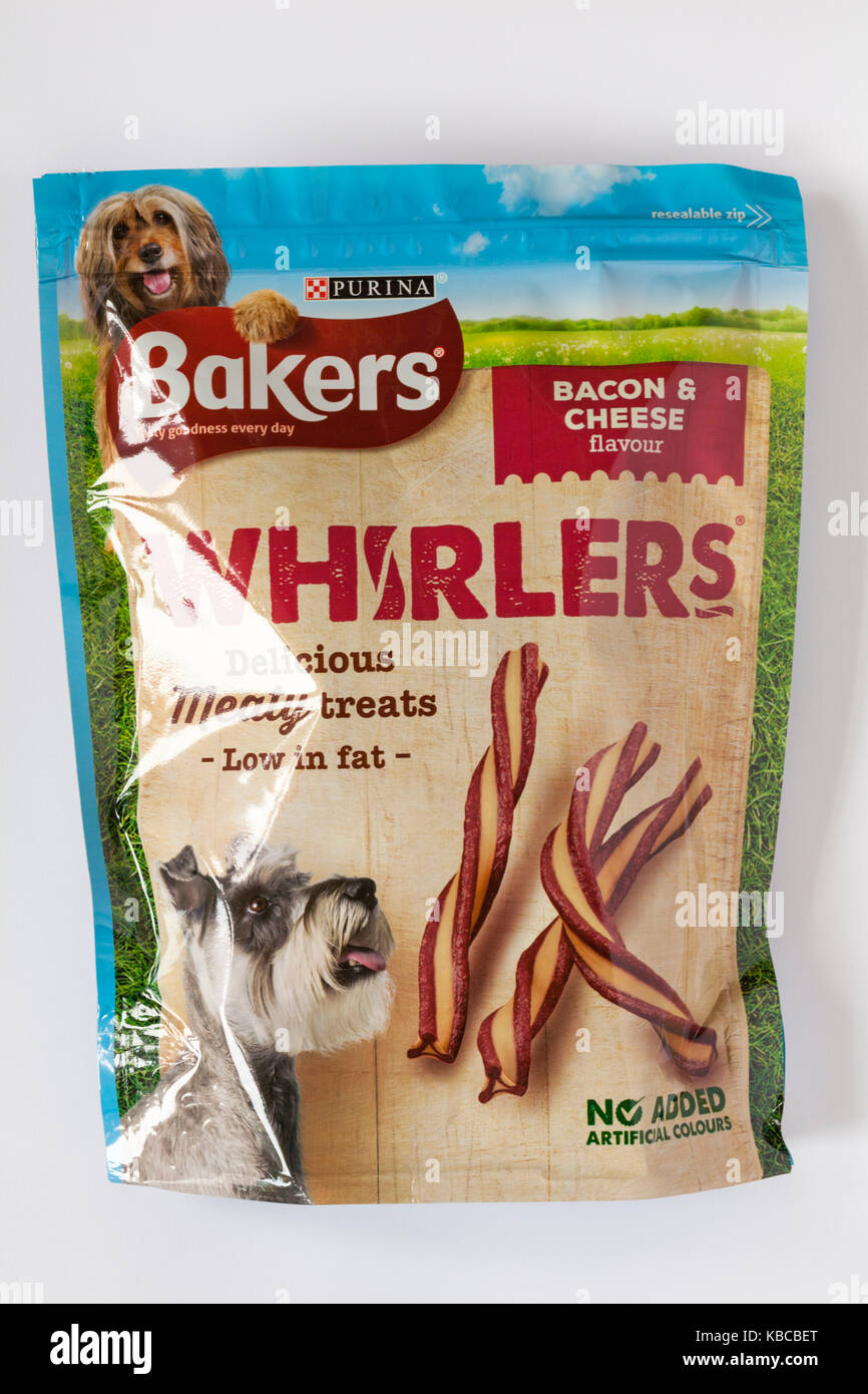 Packet of Bakers whirlers delicious meaty treats low in fat bacon & cheese flavour isolated on white background - Stock Image