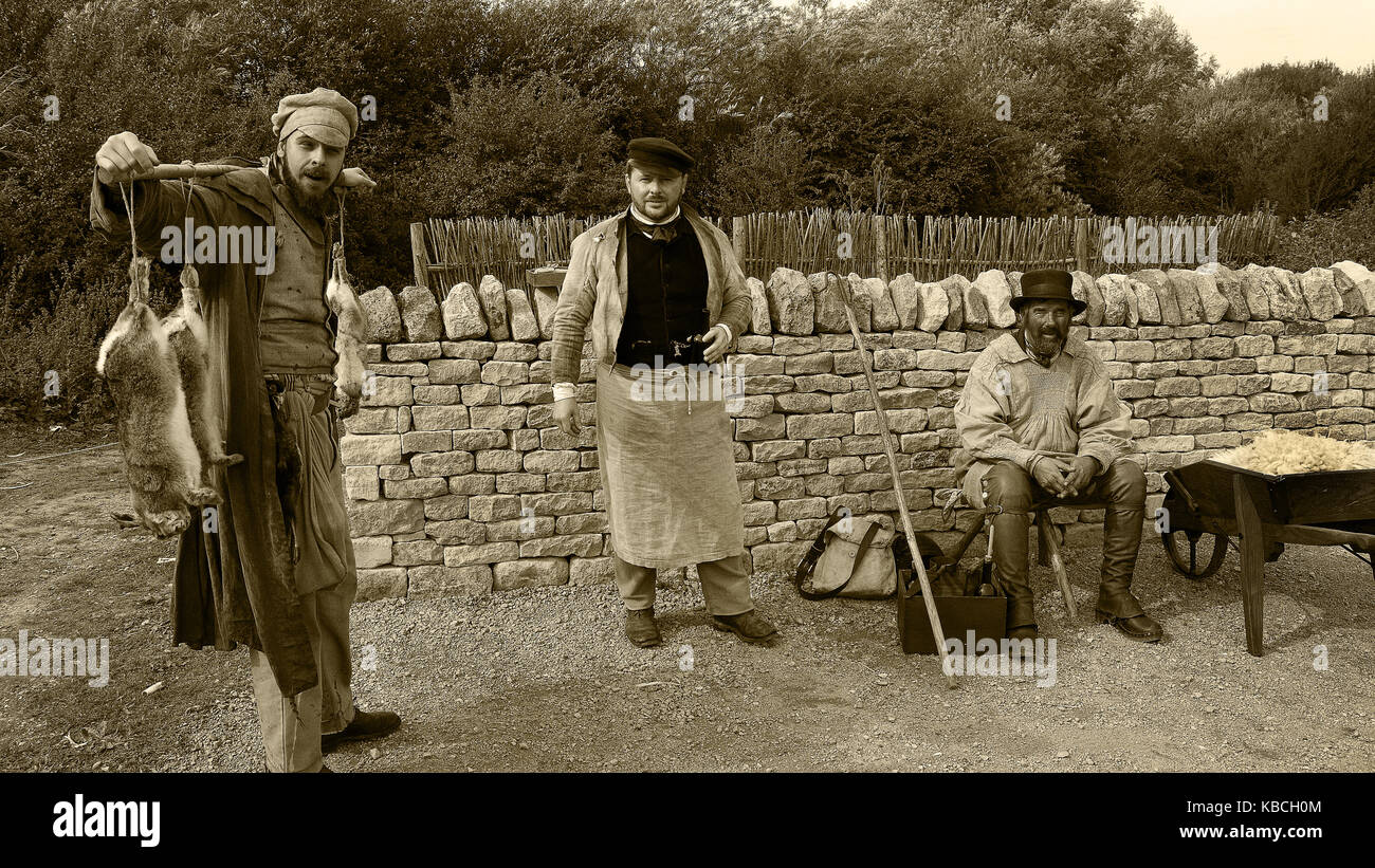three Victorian tradesmen together in sepia photo - Stock Image