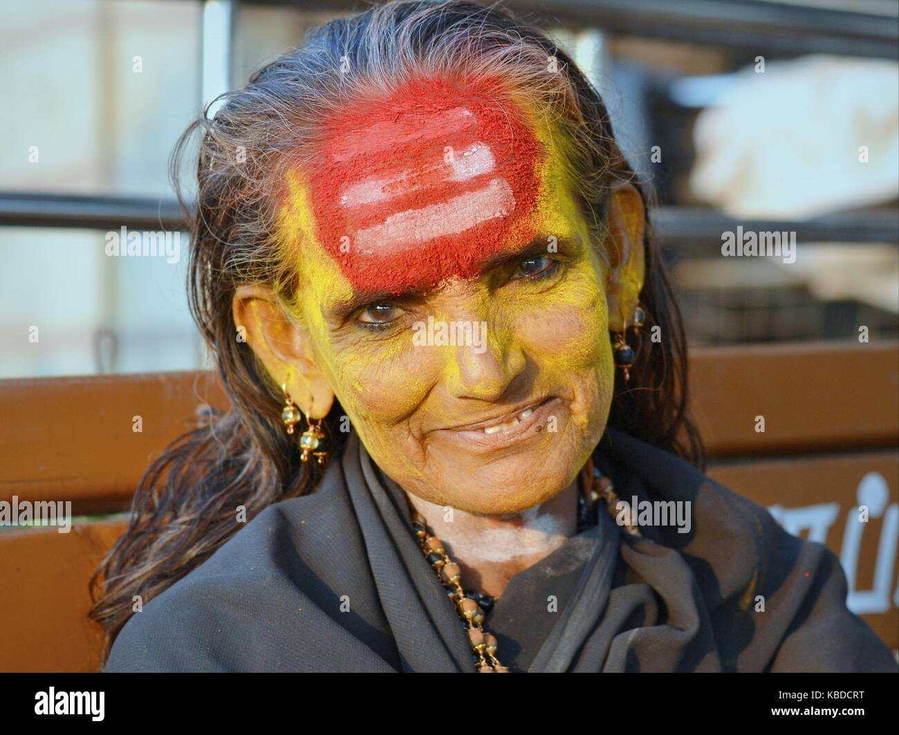 Middle-aged Shaivite female sadhu (holy woman aka sādhvī who worships Shiva) with very distinctive tripundra on - Stock Image