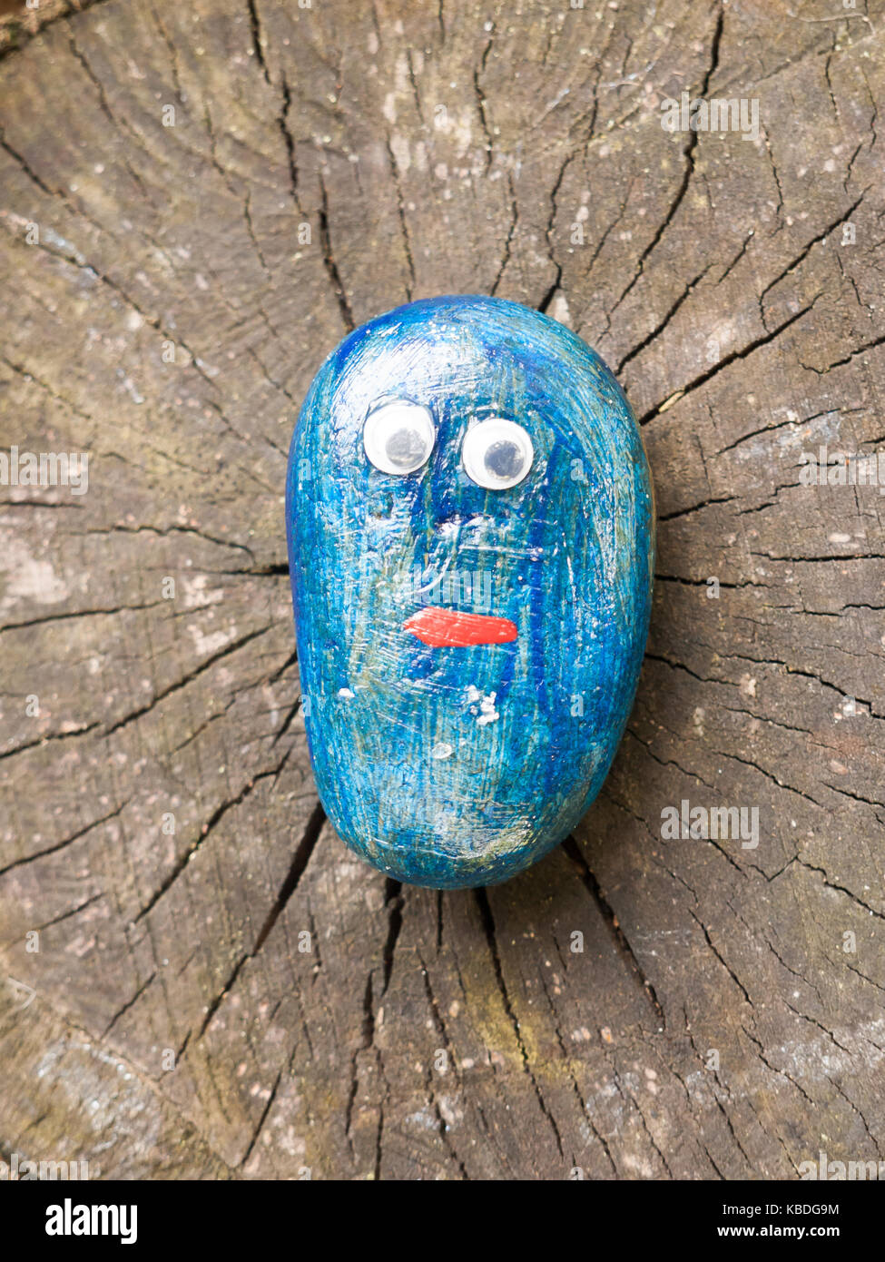 close up of funny cartoon painted children blue stone with eyes; Essex; England; UK - Stock Image
