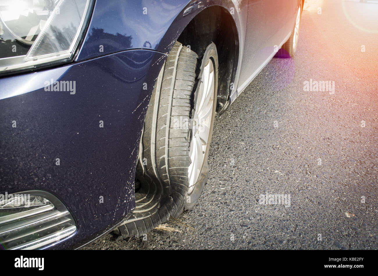 damaged tire after tire explosion at high speed on highway Stock Photo