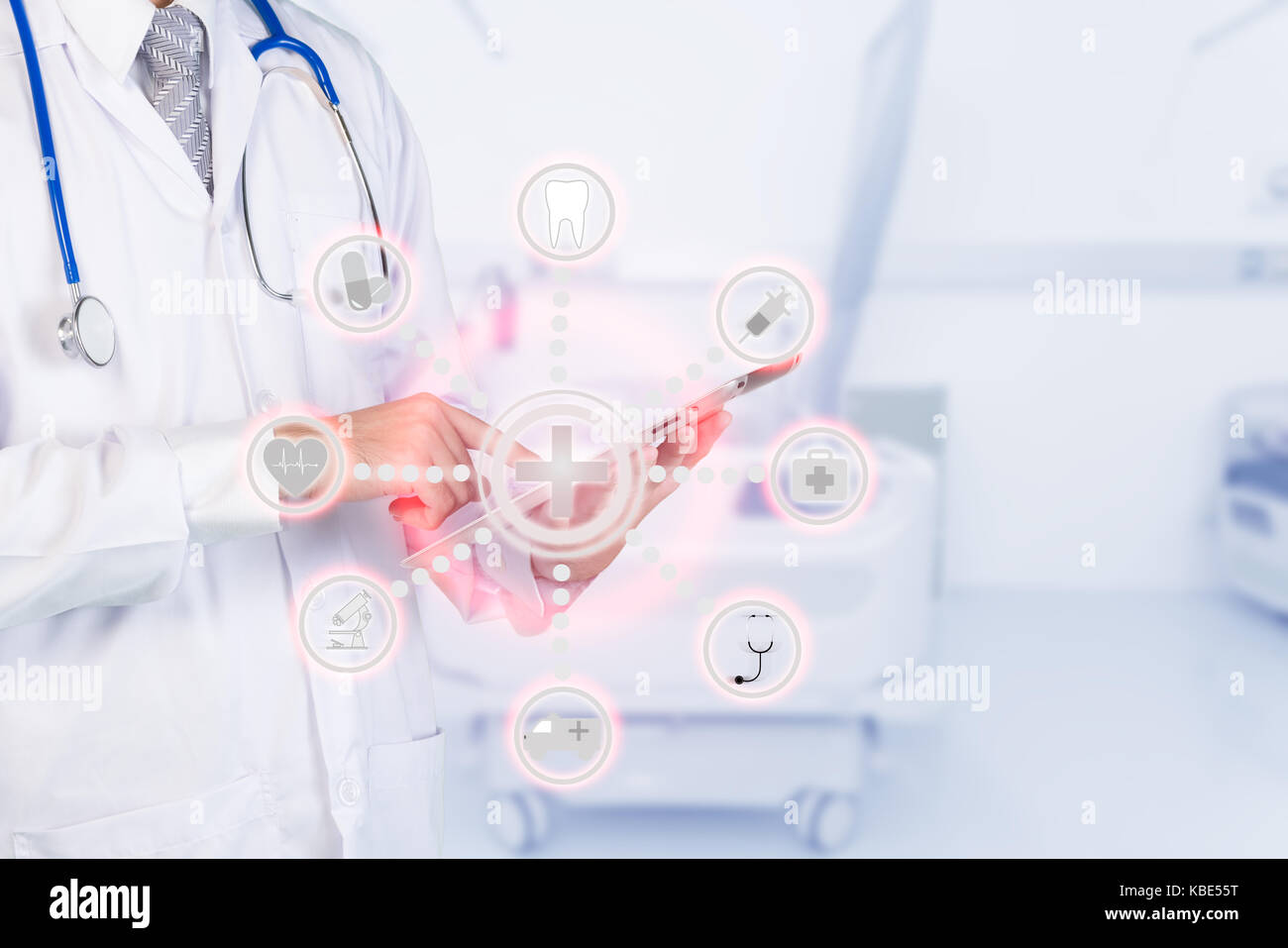 Smart medicine doctor using automation app on digital tablet in a hospital. Internet of things concept at hospital. - Stock Image
