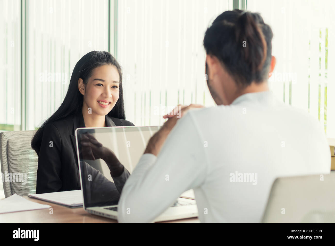 Job interview - Photo of Asian businessman applicant during listen to candidate answers. - Stock Image