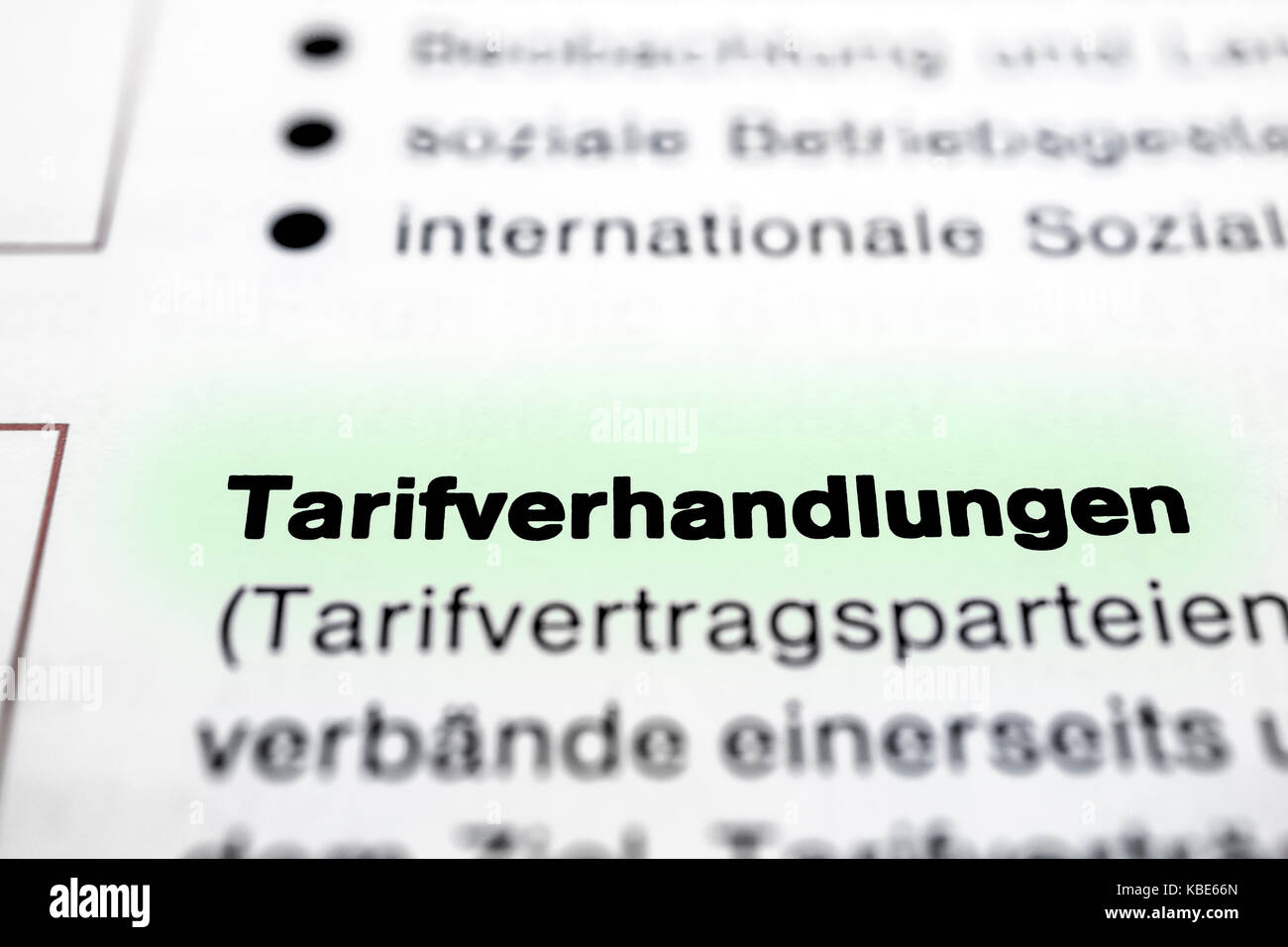 Text on page Collective Negotiations in  ( German - Tarifverhandlungen ) highlight horizontal closeup Stock Photo