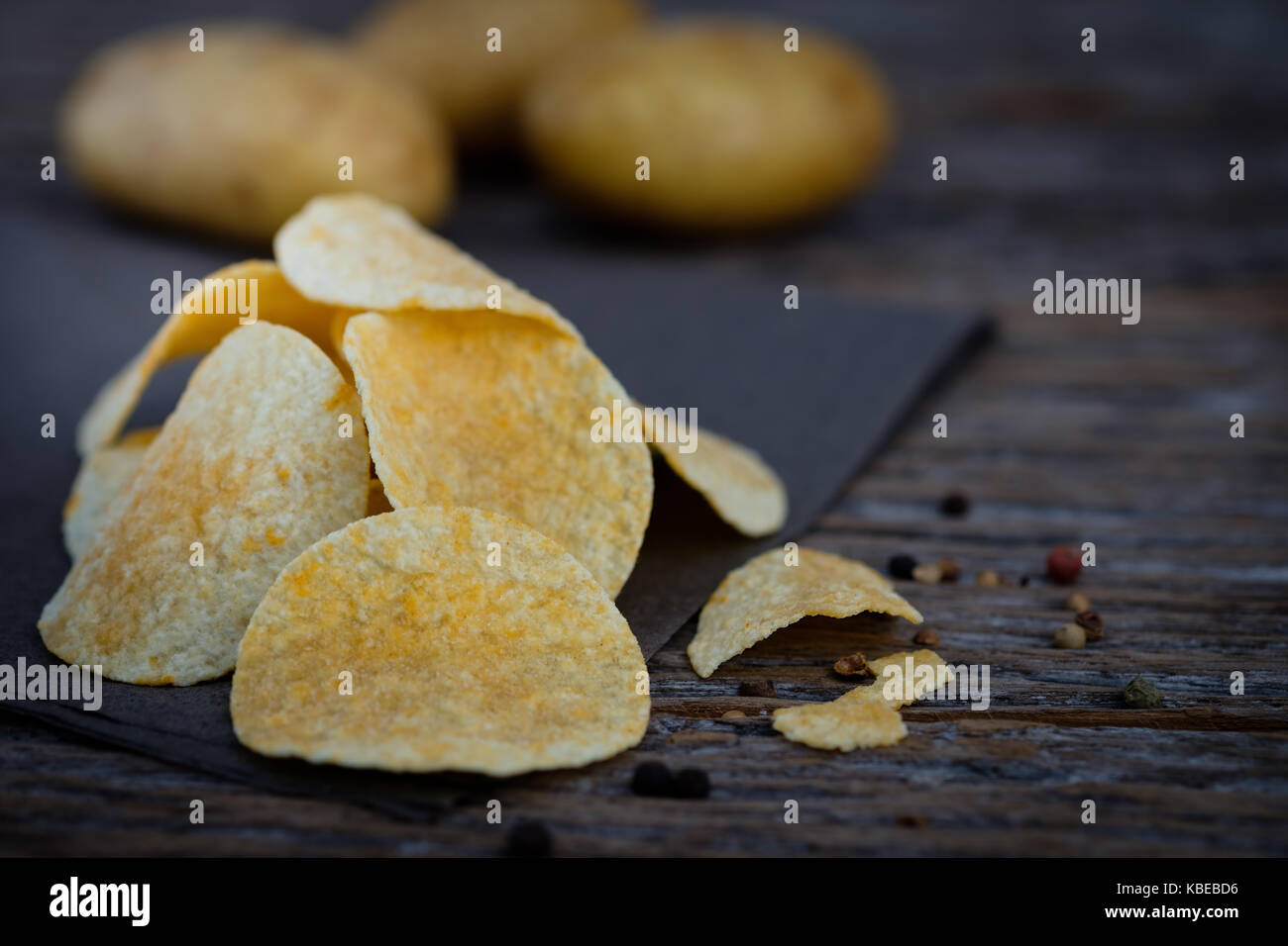 Potato chips on wooden background Choose focus point. - Stock Image