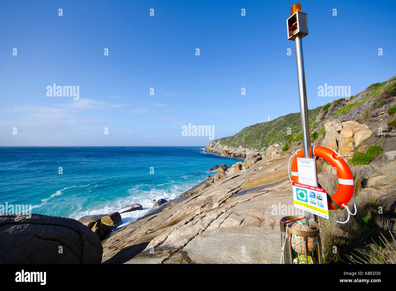 A lifebuoy at the ready on a coast notoriously dangerous for the unpredictable waves and steep slippery rock. - Stock Image