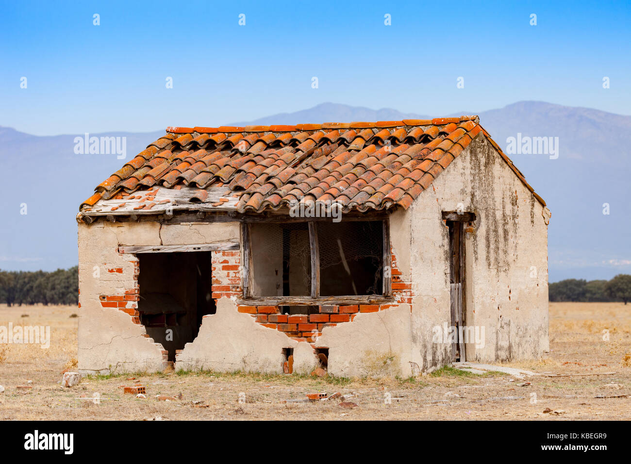 Small Old House With The Roof Collapsed And A Broken Window Stock
