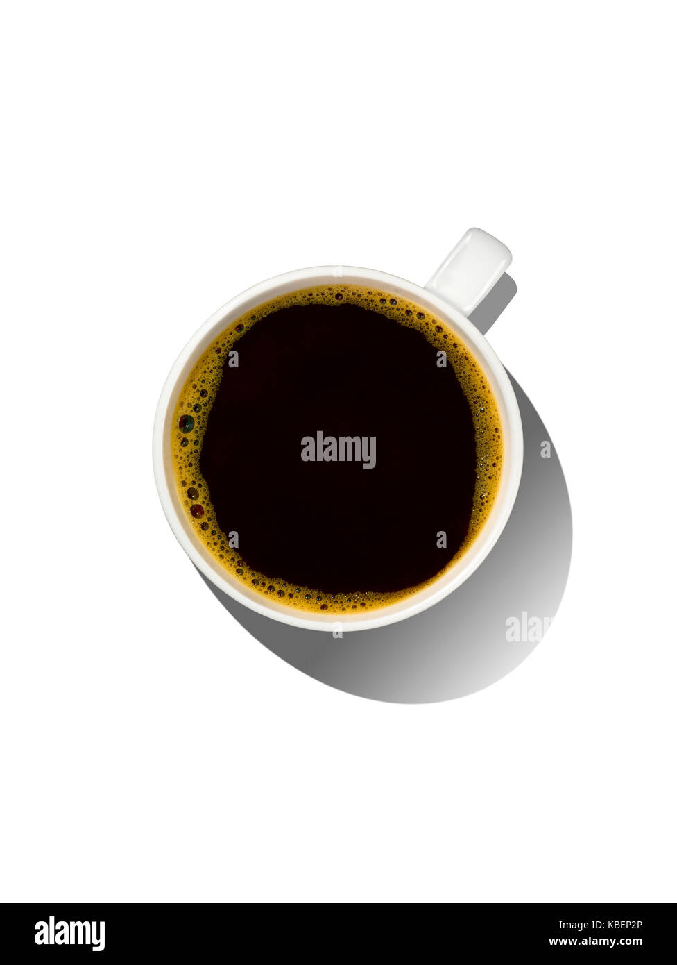 An overhead shot of a cup of coffee with shadow - Stock Image