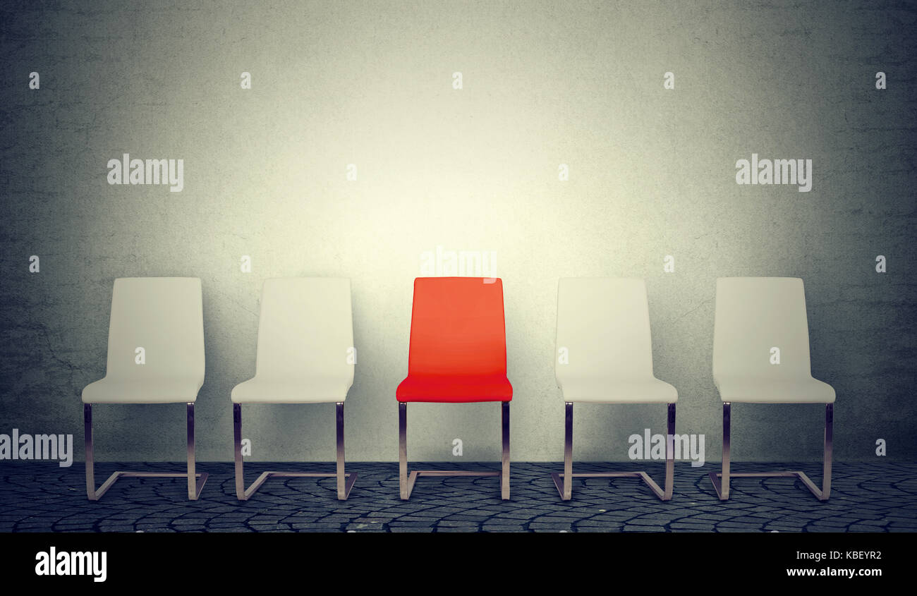 One opening for the job business concept. Row of white chairs and one red in the middle - Stock Image