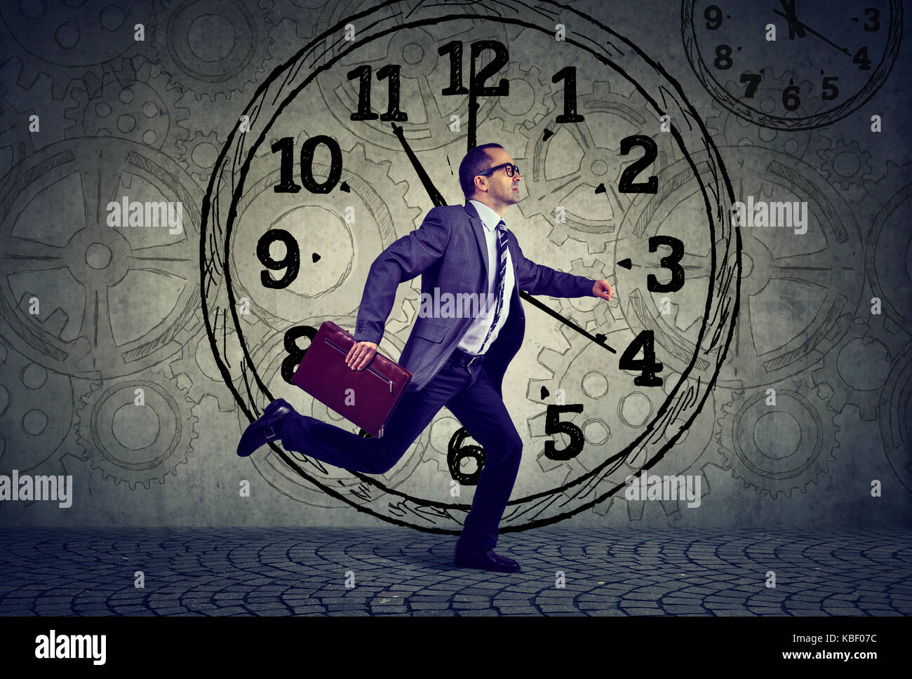 Mature business man in suit running out of time - Stock Image