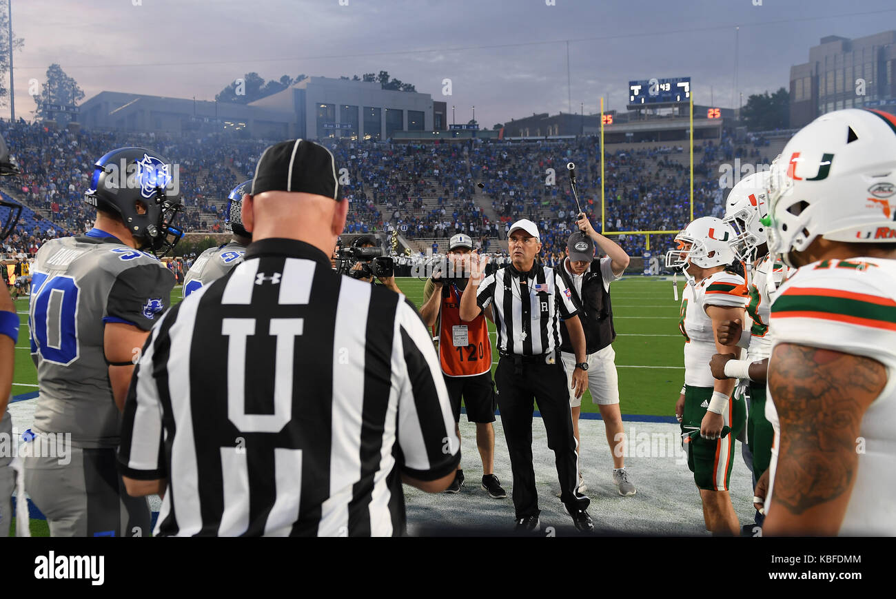 Durham, North Carolina, USA. 29th Sep, 2017. Team captains gather at the center field for the coin flip. The Duke - Stock Image