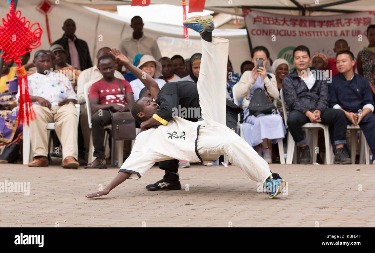 Kigali, Rwanda. 29th Sep, 2017. Rwandan teenagers perform martial arts in the community of Nyamirambo Sector in - Stock Image