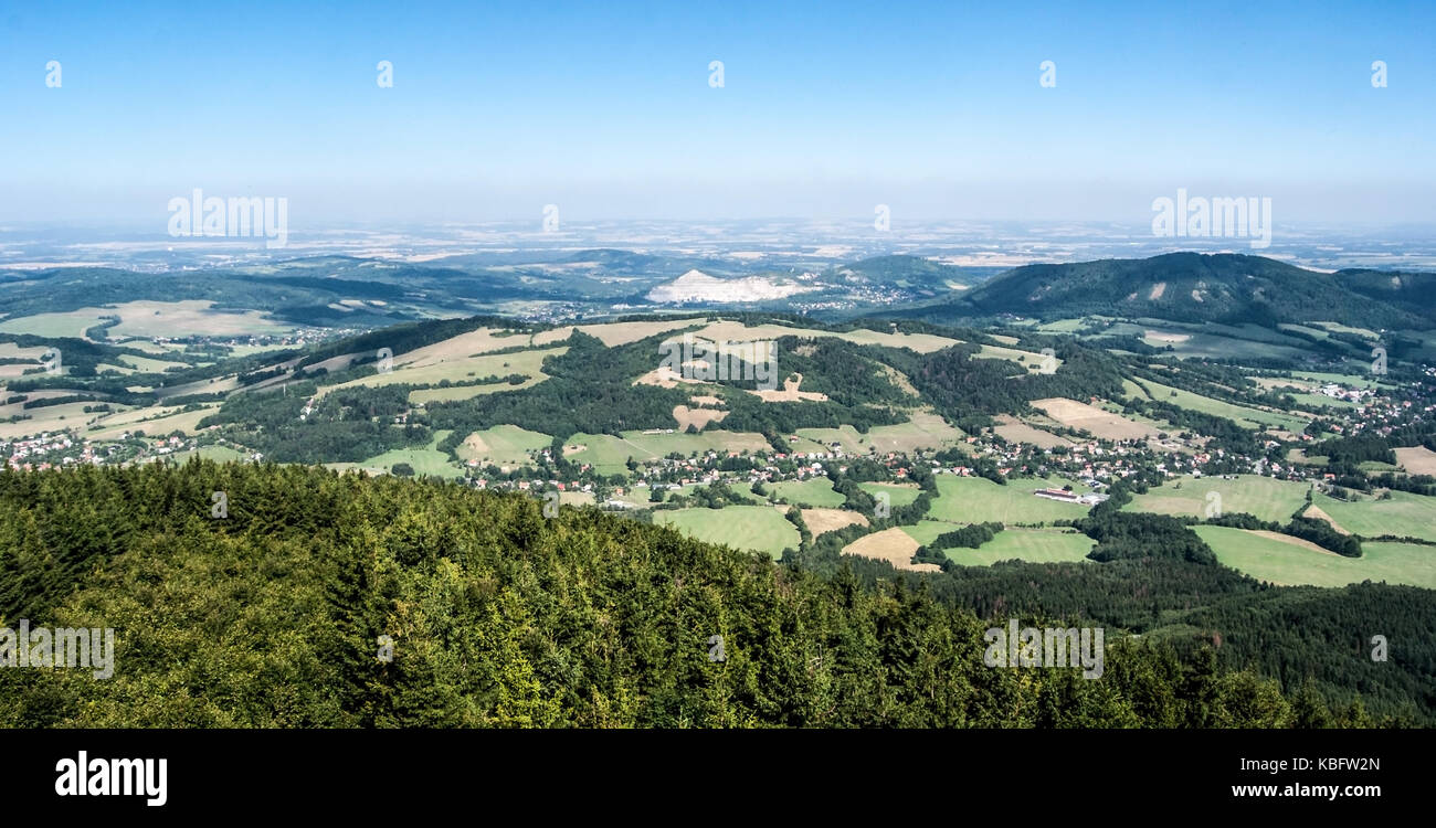 view to north from Velky Javornik hill in Moravskoslezske Beskydy mountains with countryside, villages, small hills Stock Photo