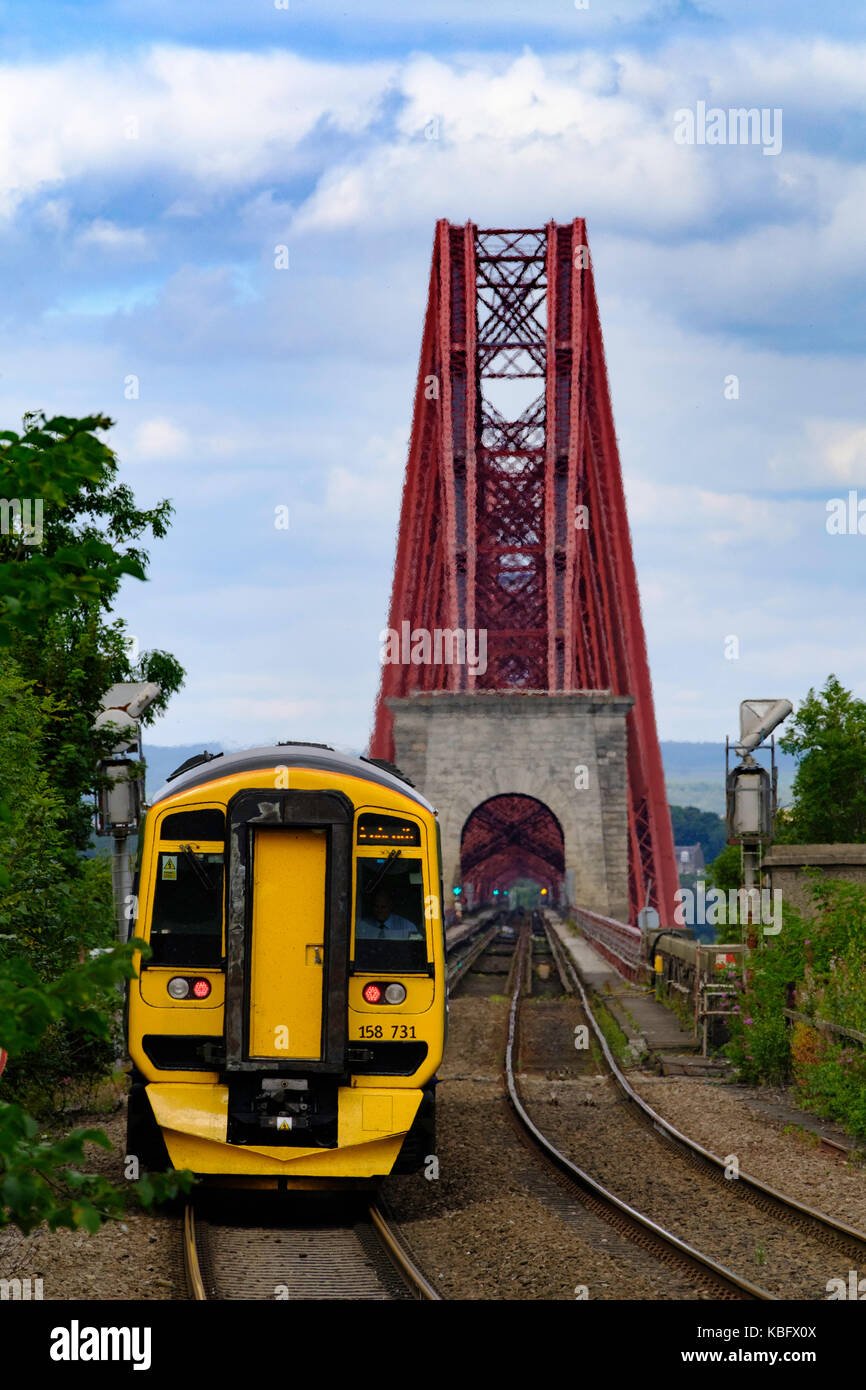 View of Scotrail passenger train approaching Dalmeny Station after crossing Forth Railway Bridge in Lothian , Scotland, - Stock Image